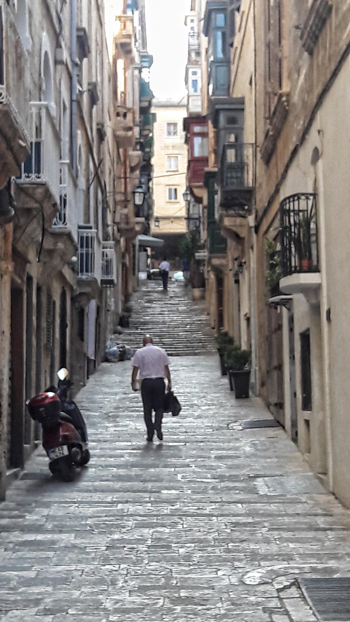 A narrow street in Valletta, Malta by peter.busuttil