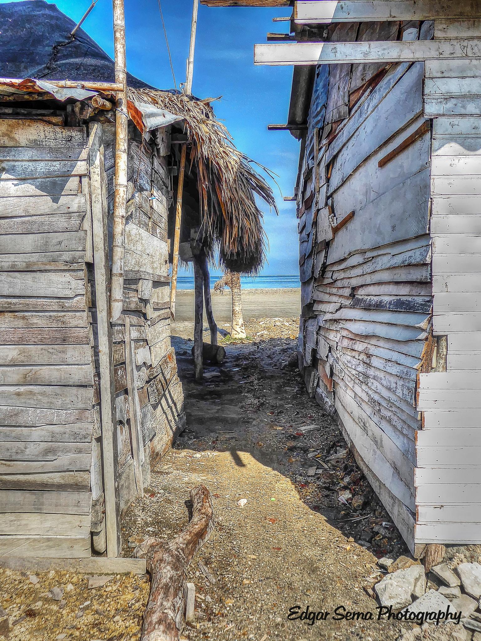 Houses at beach by Edgar Serna