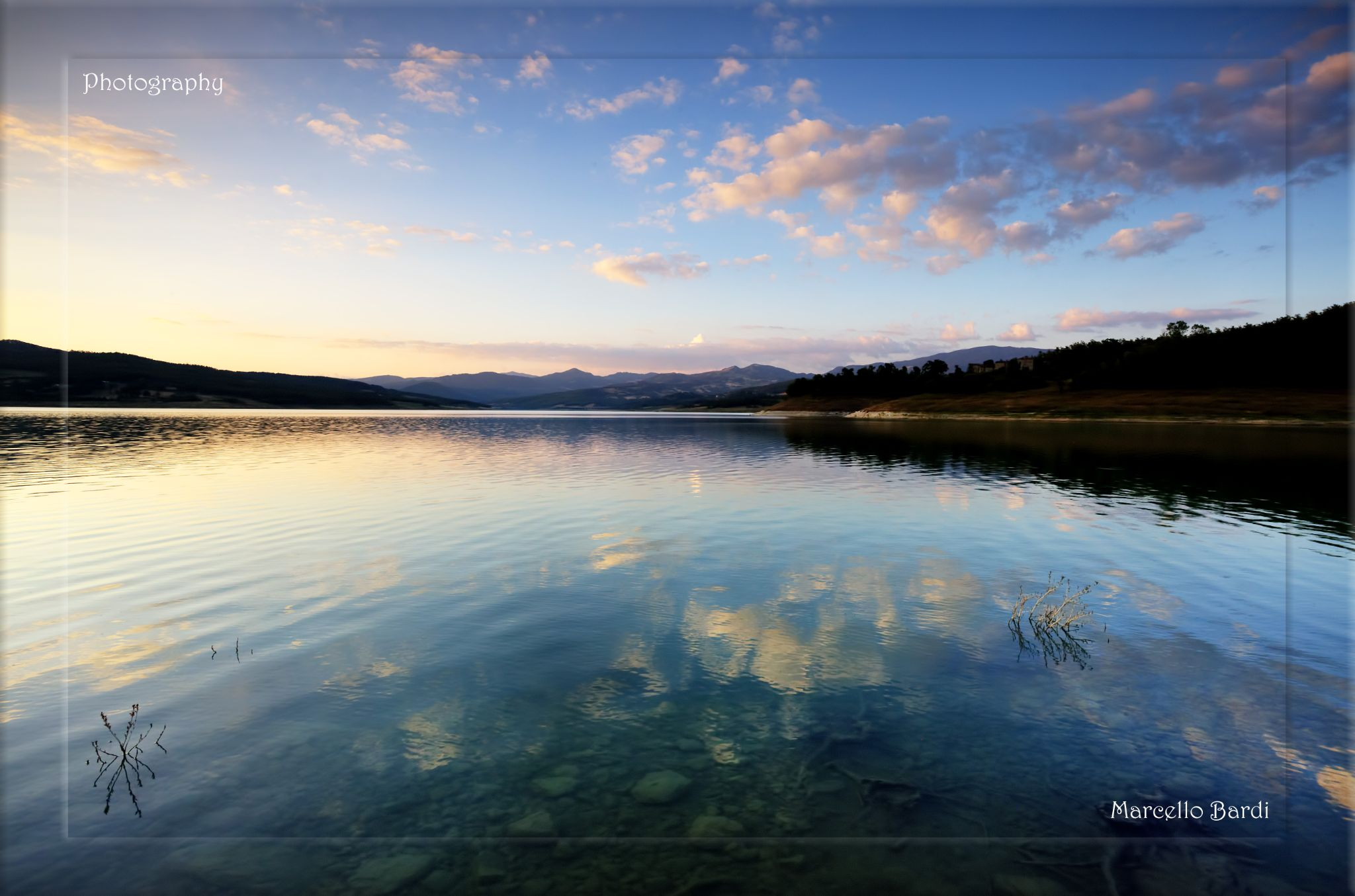 Clouds in the lake by marcello.bardi.3