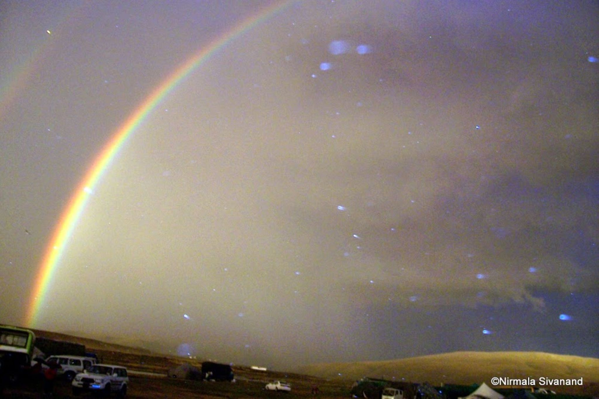 Rainbow at Manasarover by Nirmala Sivanand