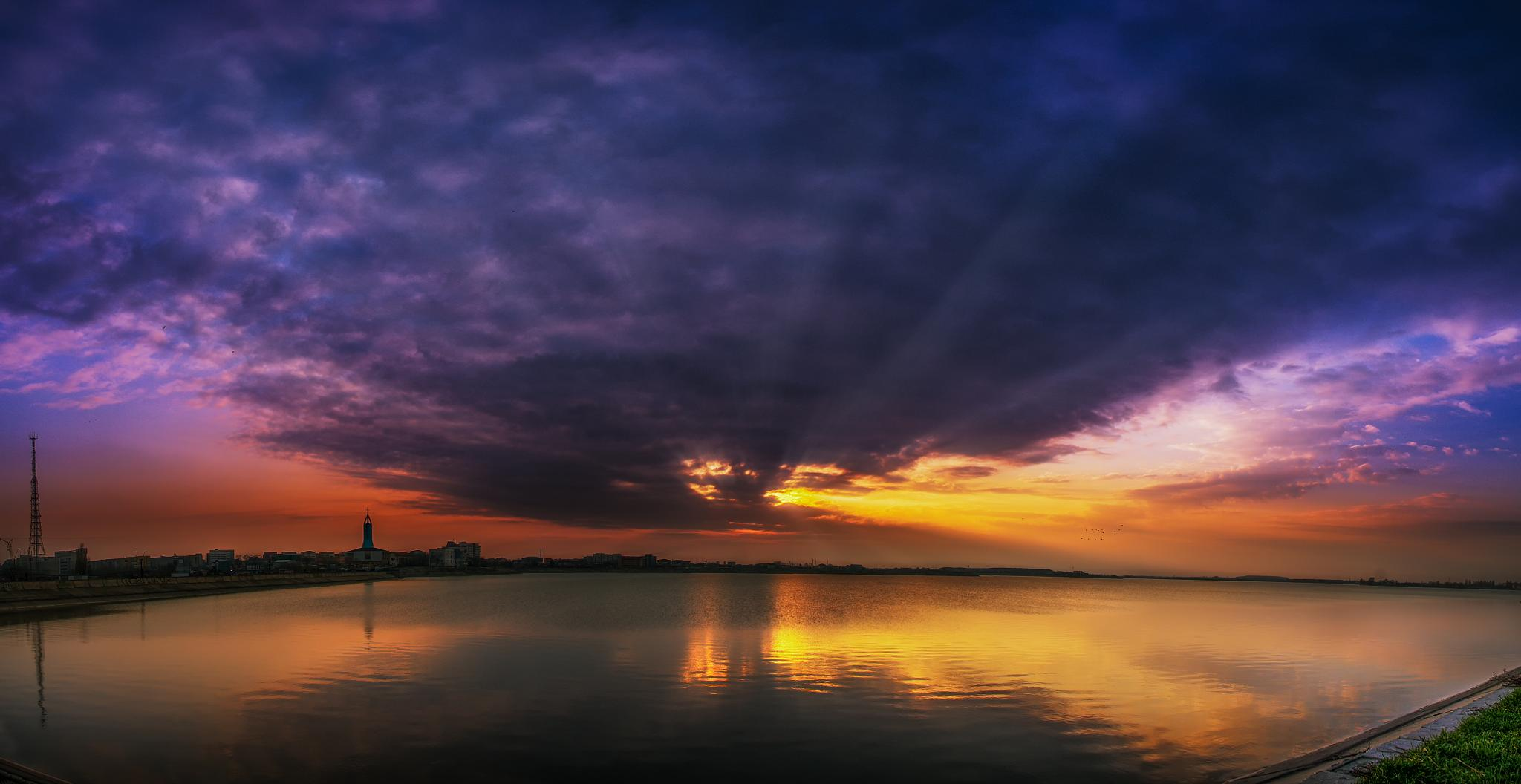 Sunset Beneath the Clouds by Ionut Petrea