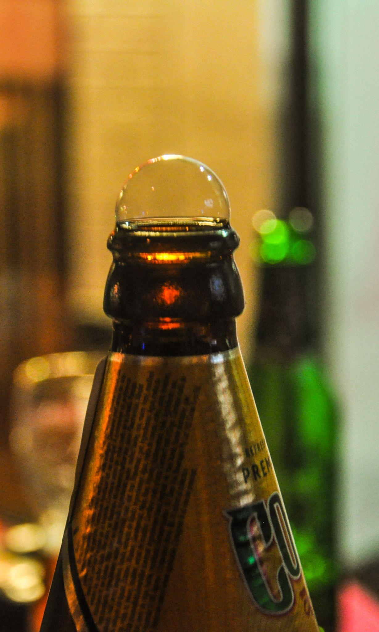 Bubble on bottle by Dimitris Gkoutzamanis