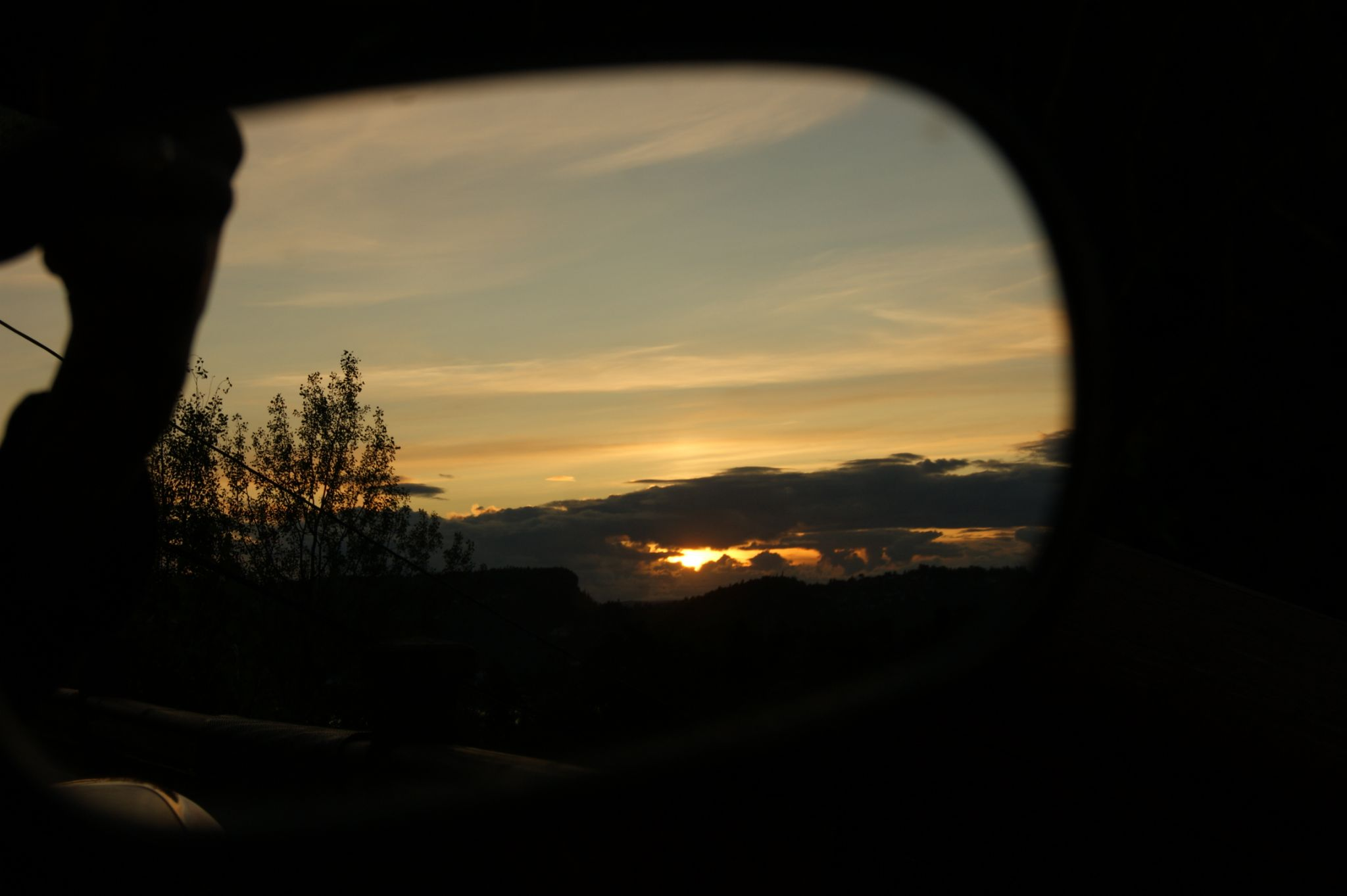 Sunset in the rearview mirror by kristin.vaa