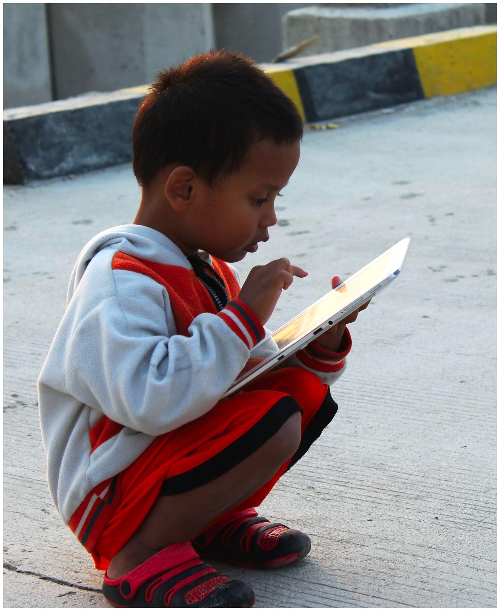 The boy with tab.( My Son ) by dina.budibud