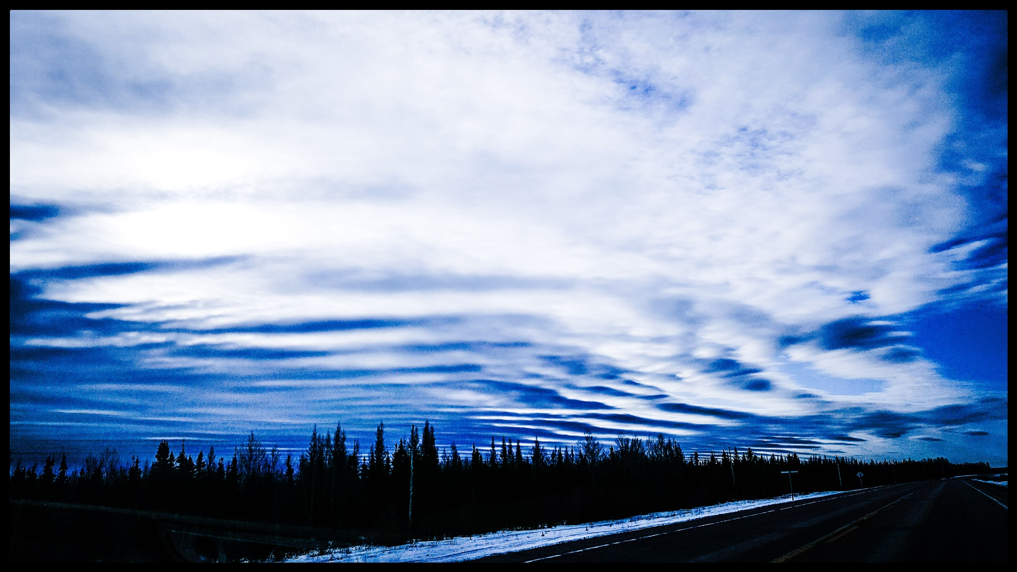 Clouds down the highway by Annette McCann