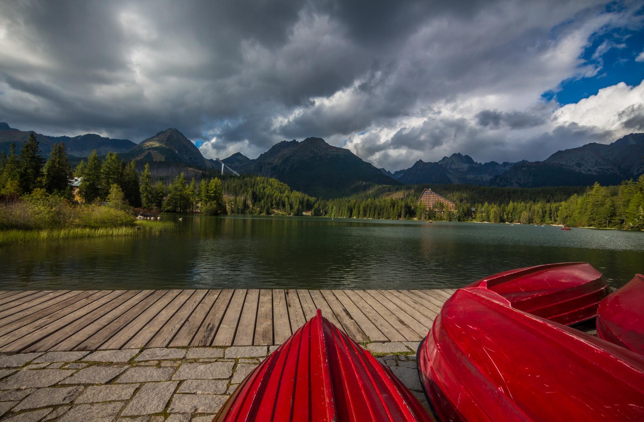 Red boats by Laco Hubaty
