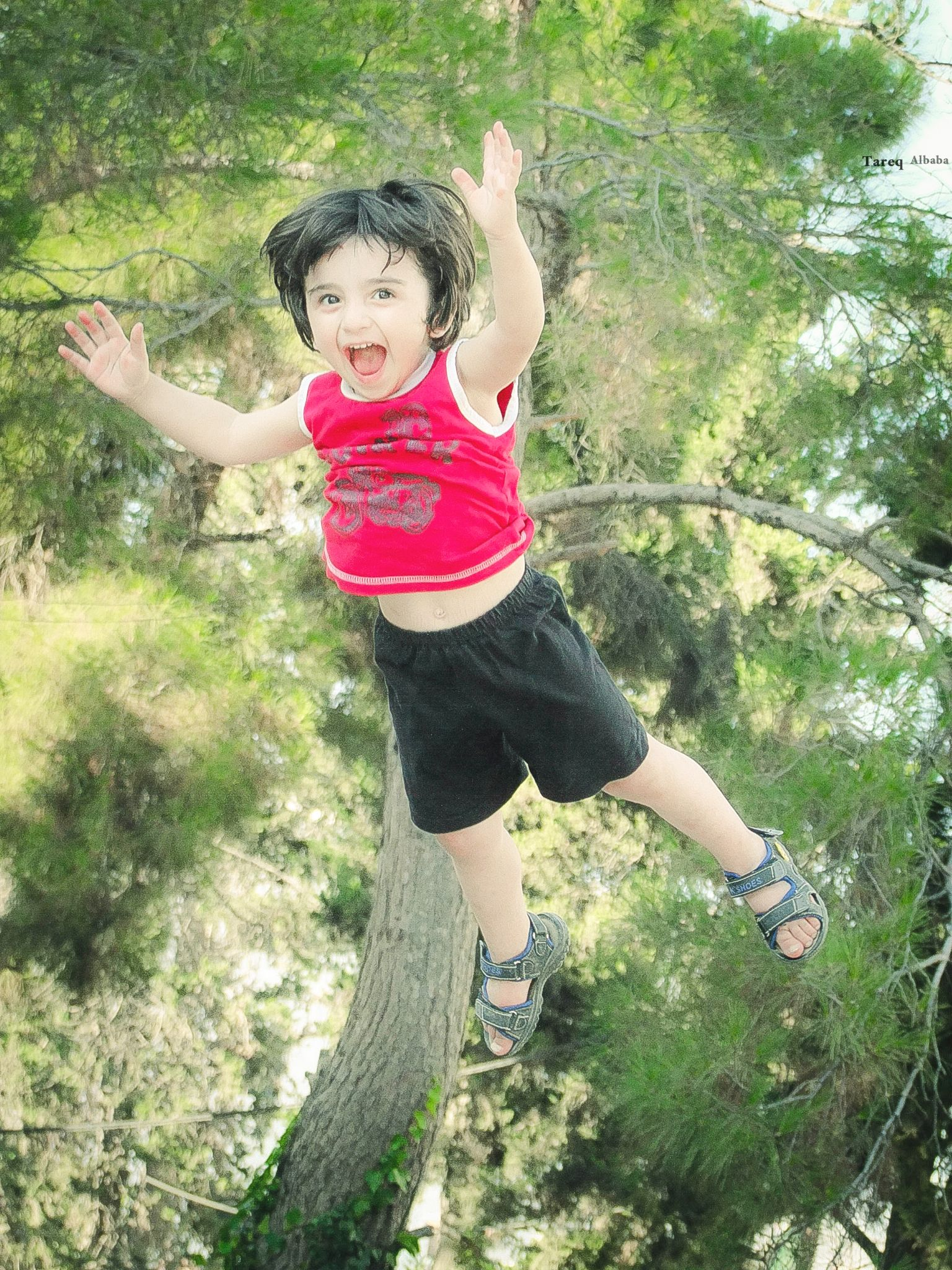 because he trusts his father ~ he enjoys flying   by Tareq Albaba