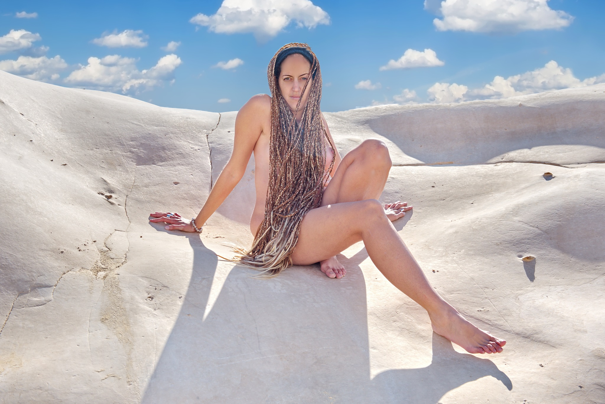 A woman's curves and curves of rock by Moti fine art nude photography