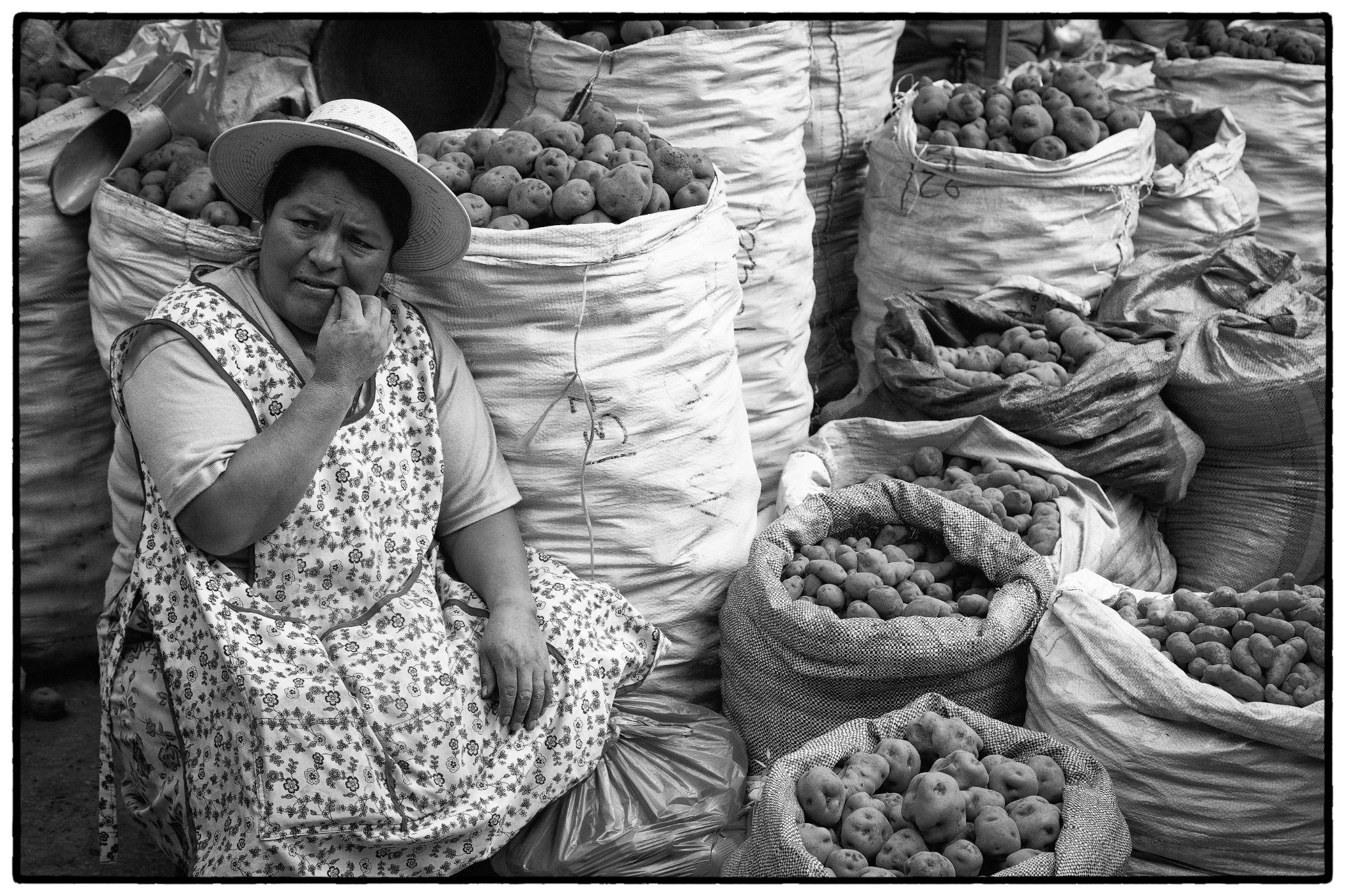 Potato Seller by Stilfoto