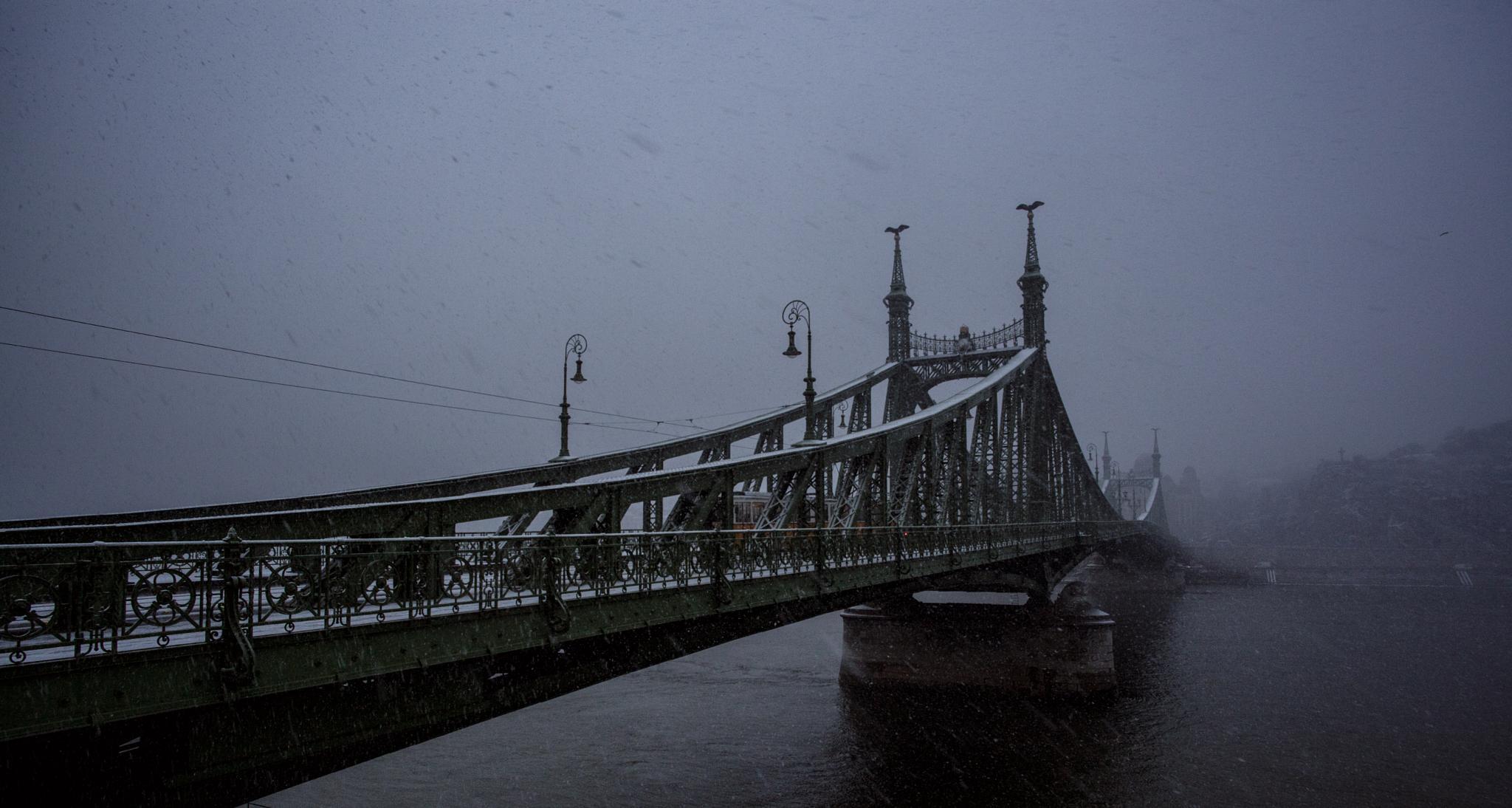 Snow over the bridge by Matej Kmet
