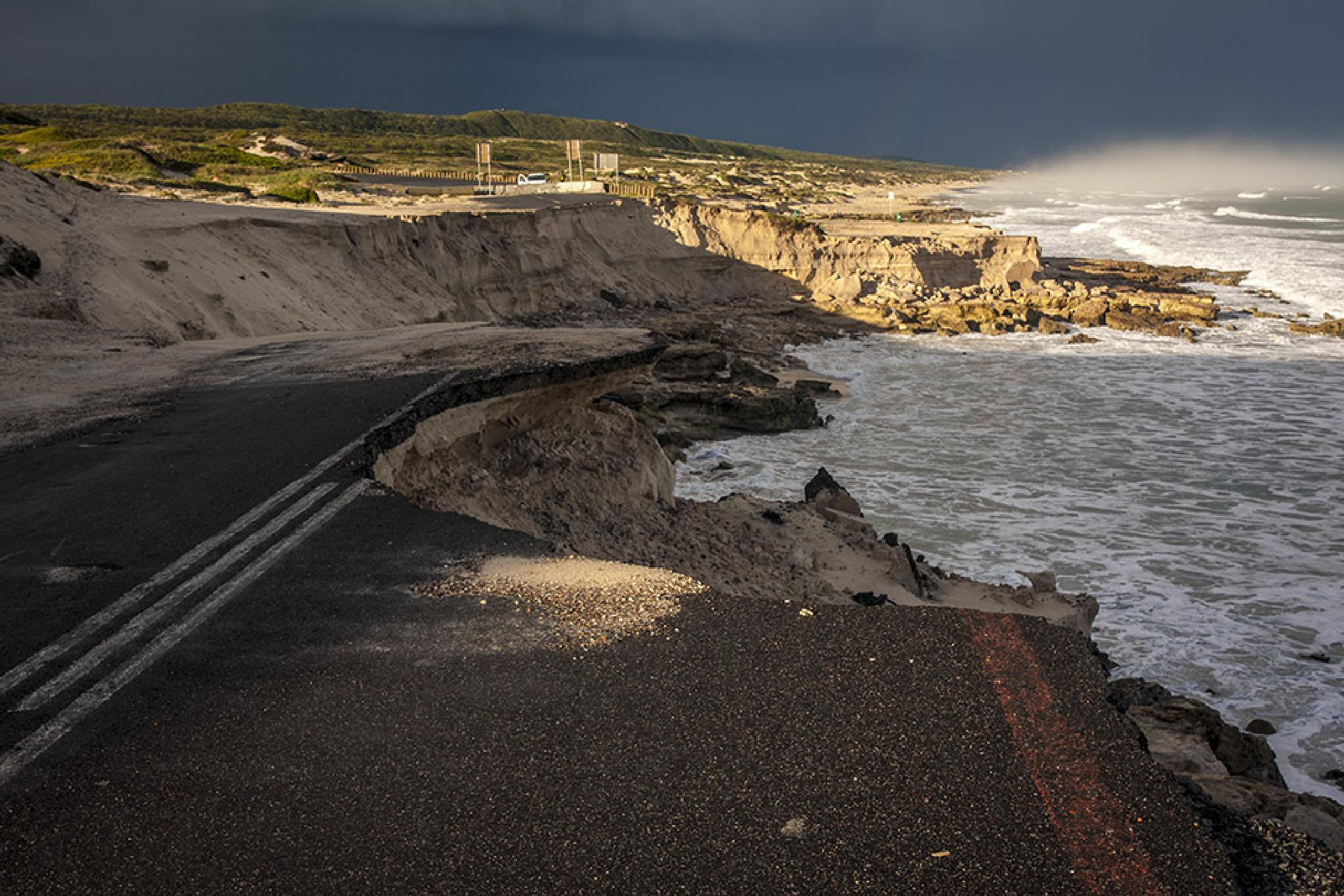 Photo in Sea and Sand #sea #ocean #storm #damage #broken #road #tar
