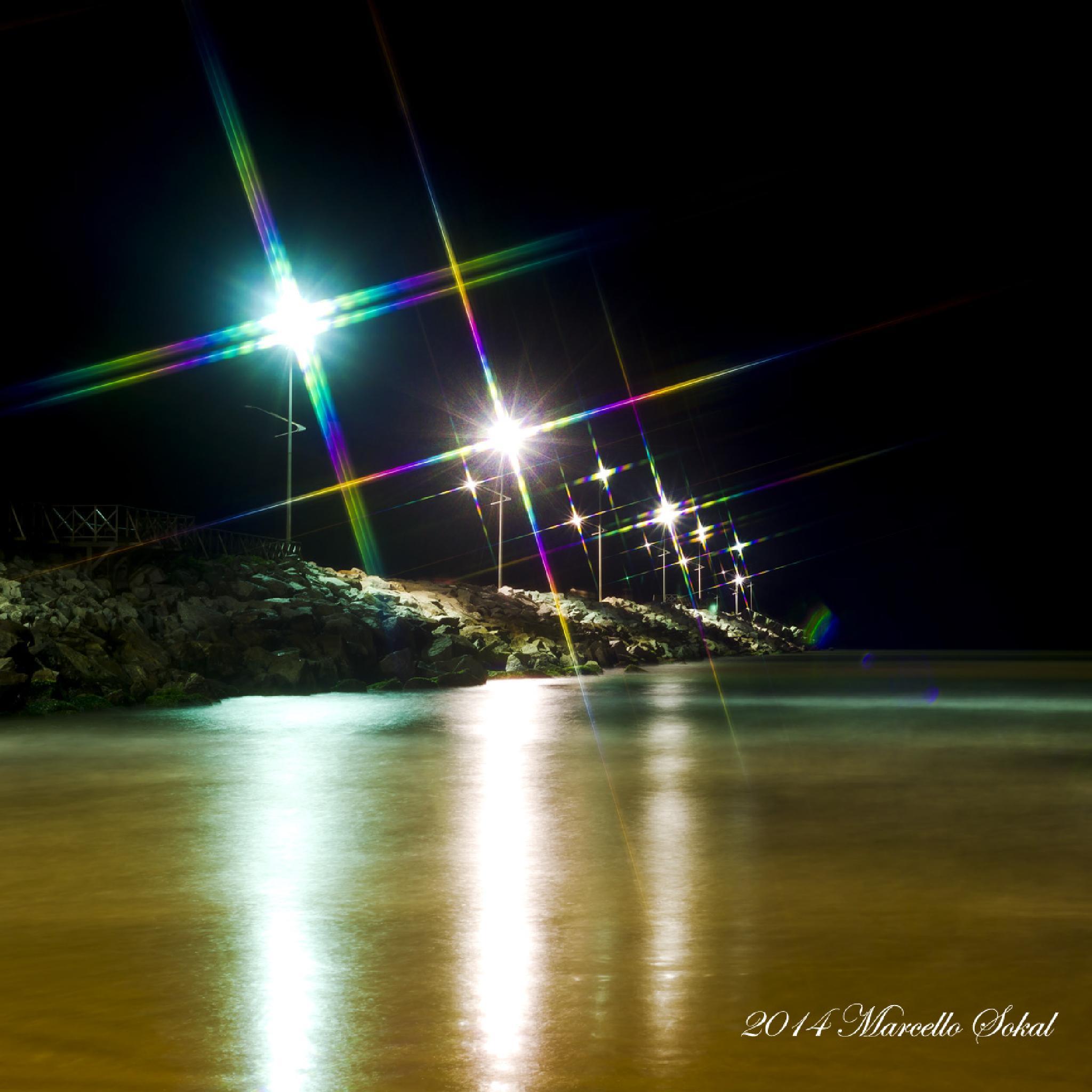 The atalaia beach at night by marcello.sokal