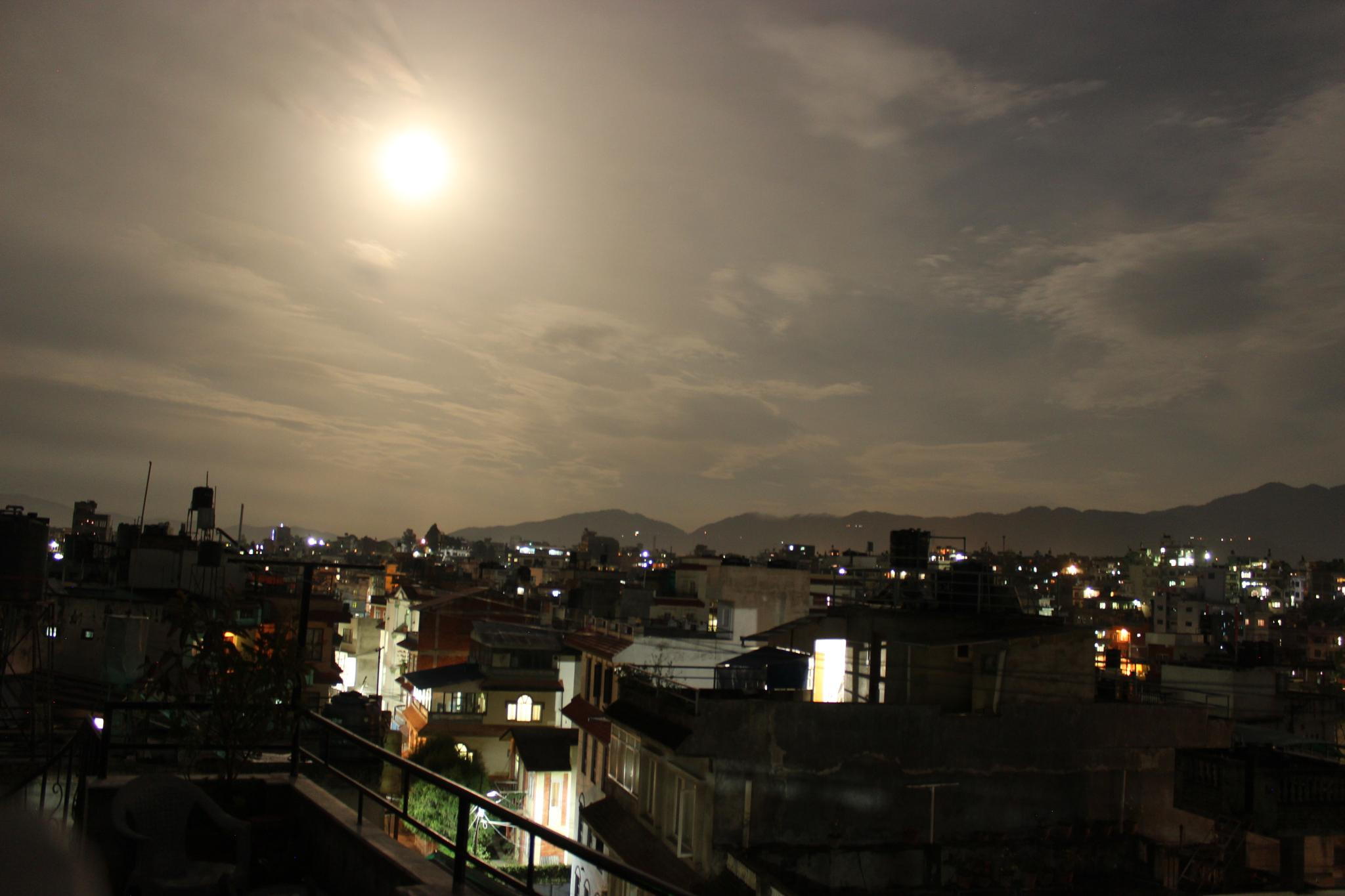 cityscape on full moon by rajivkilanashrestha