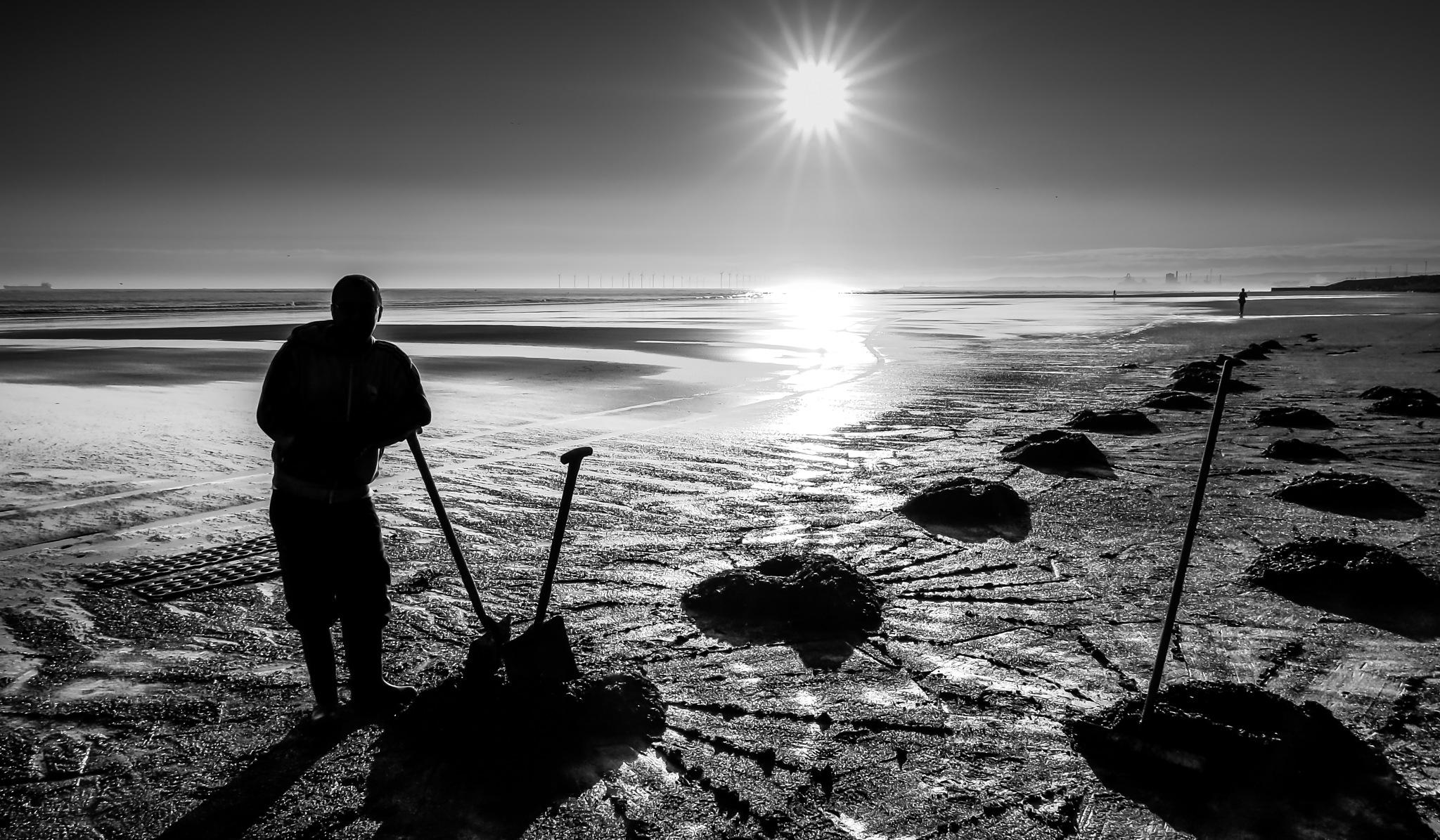 Beach coal collector by Peter Edwardo Vicente.
