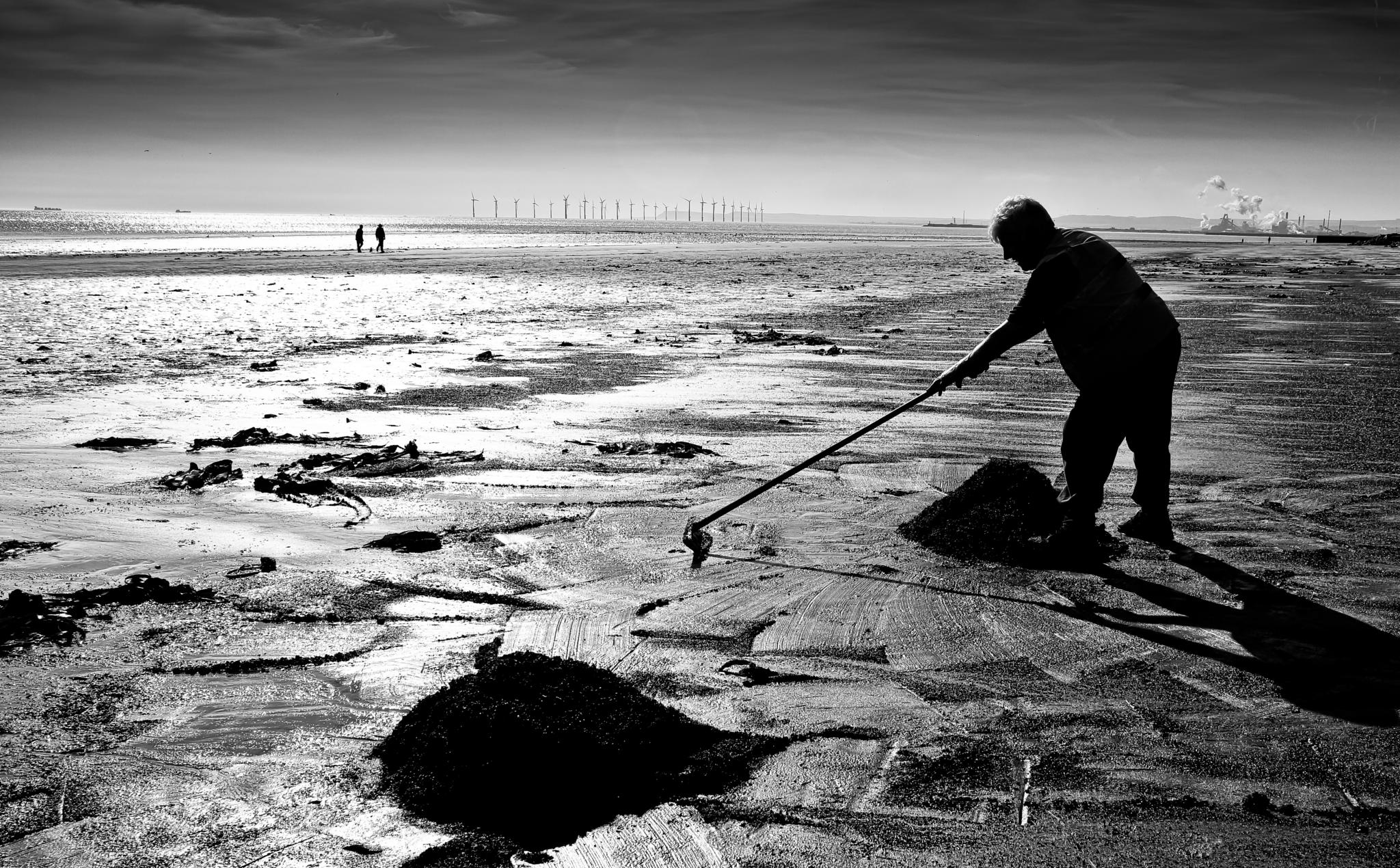 Collecting beach coal by Peter Edwardo Vicente.