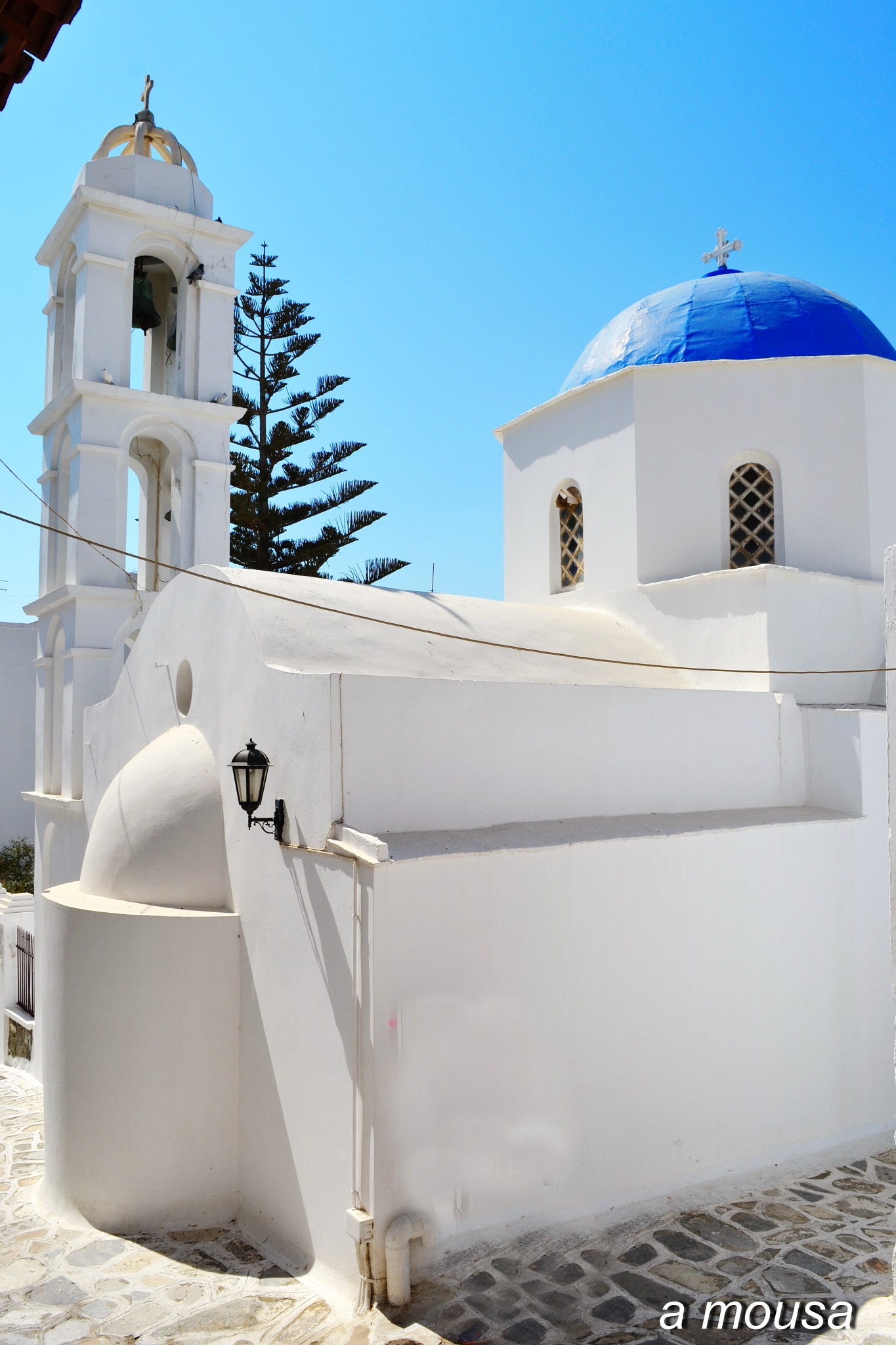 white orthodox church, in Tinos island by alexandra.tsamimousa