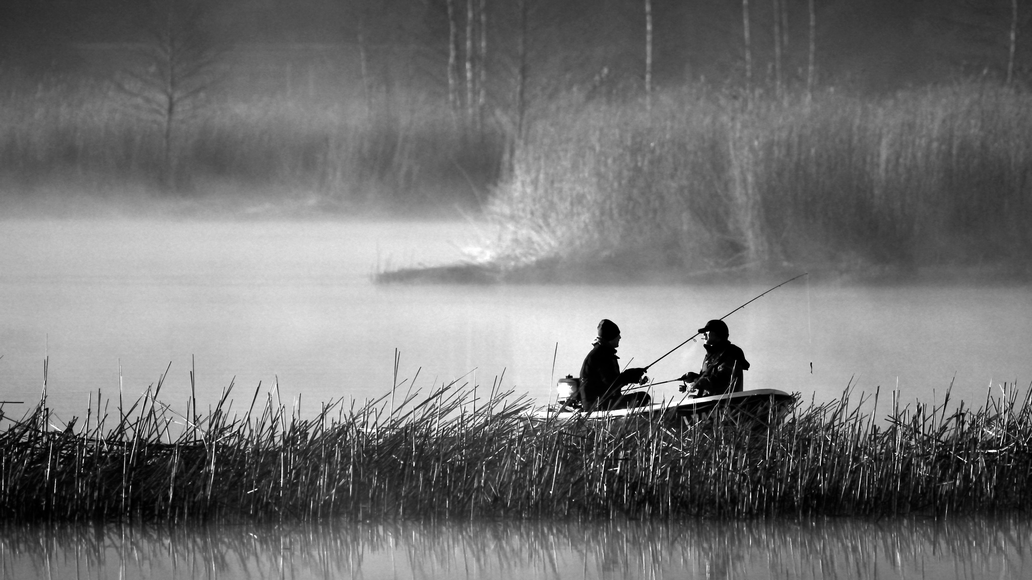 Fishermen in morning fog on the river by Art Wind