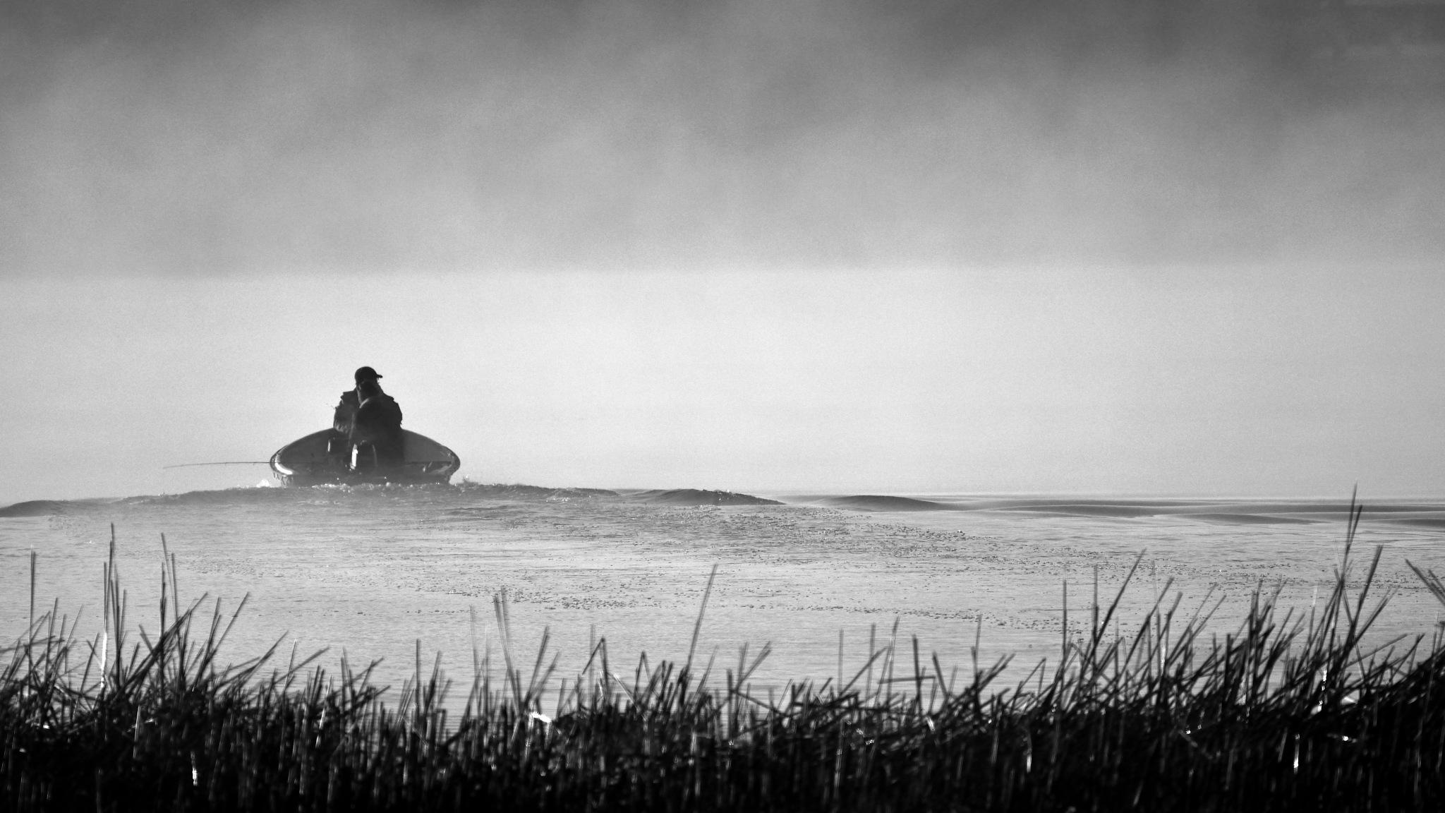 Fishermen in morning fog on the river by Art Wind