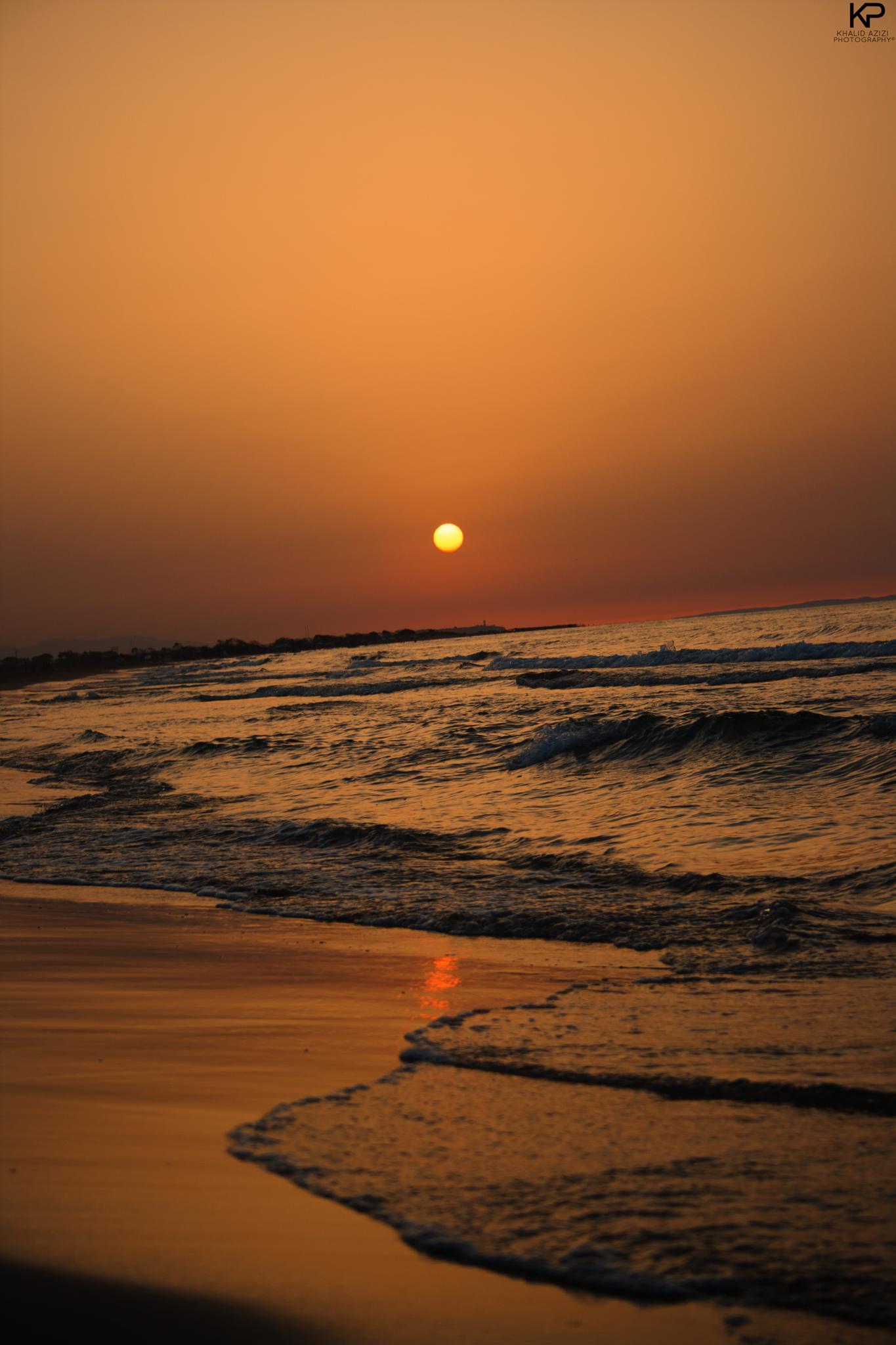 Beach sunset by Khalid Azizi
