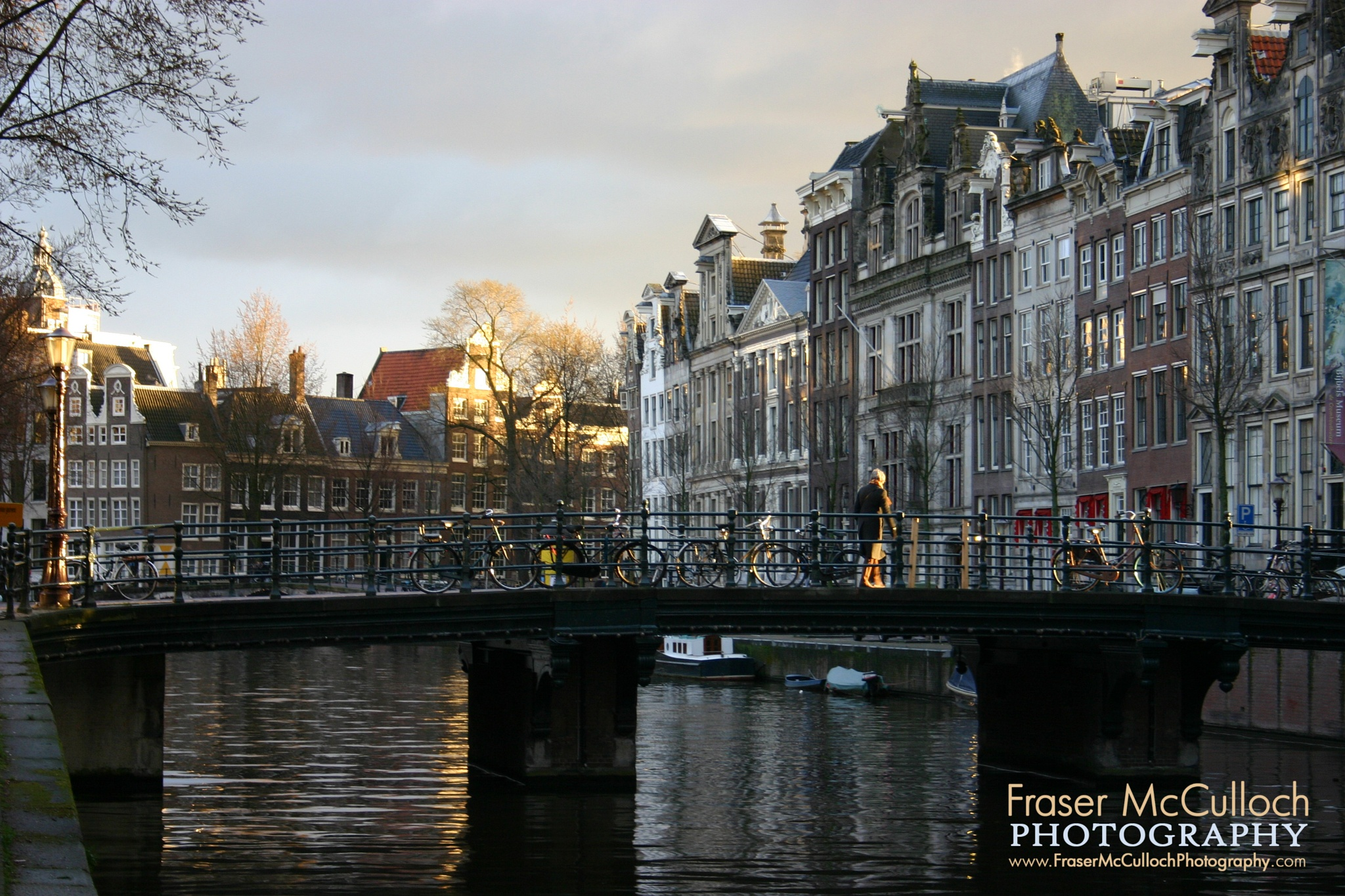 Photo in Cityscape #setting #sun #amsterdam #holland #canal #bicycle #netherlands