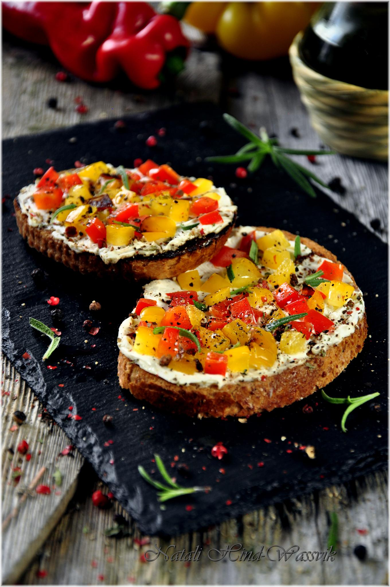 Fried crusty bread with Philadelphia cheese, rosemary and grilled bell peppers by natalja.hind.wassvik