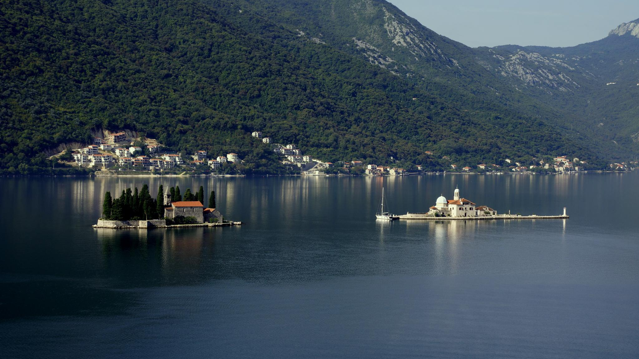 Two picturesque islands in frant of Perast, the town which was described just a moment before. by sreten nakićenović