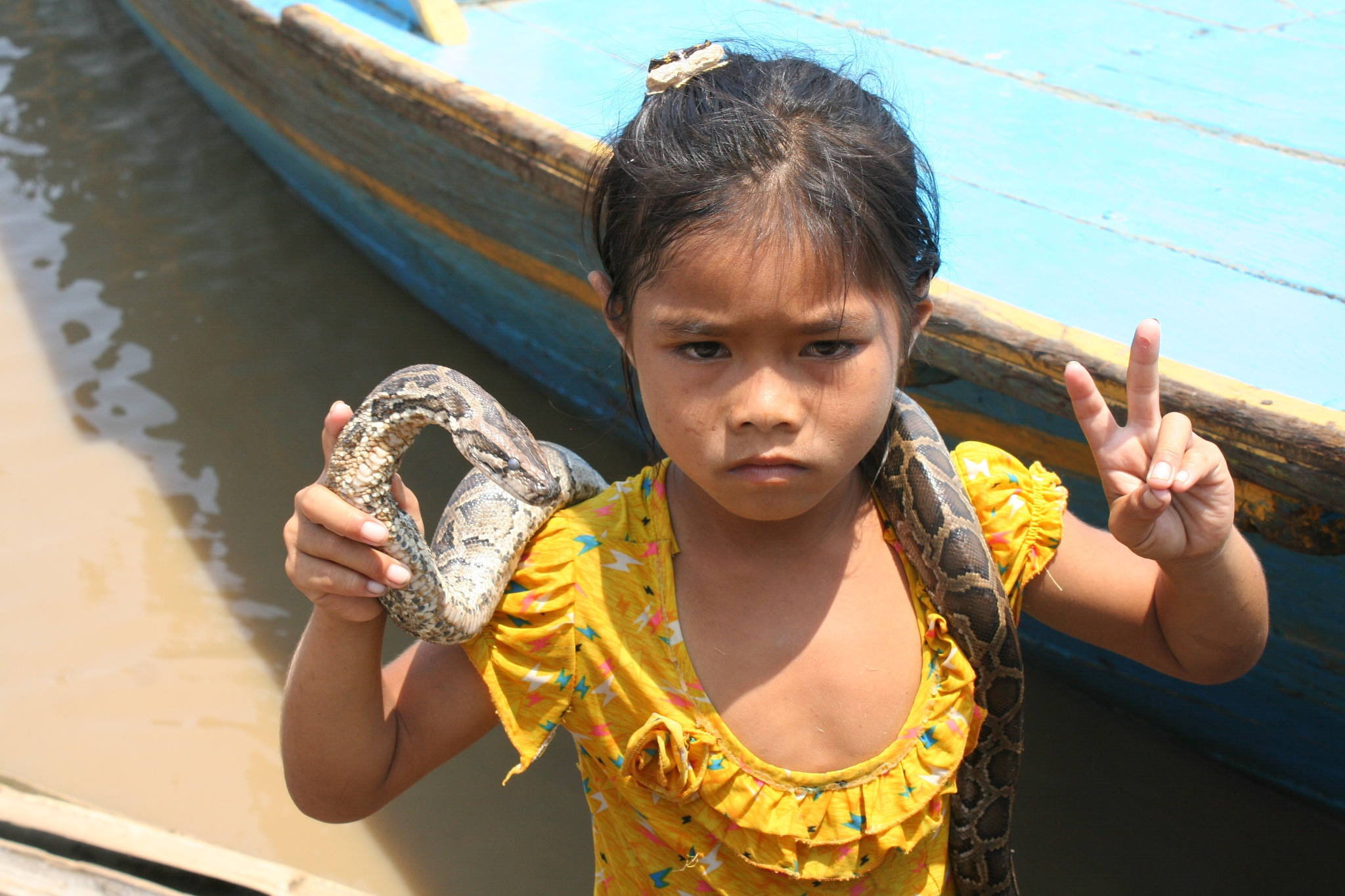 Photo in People #snake #girl #floating village