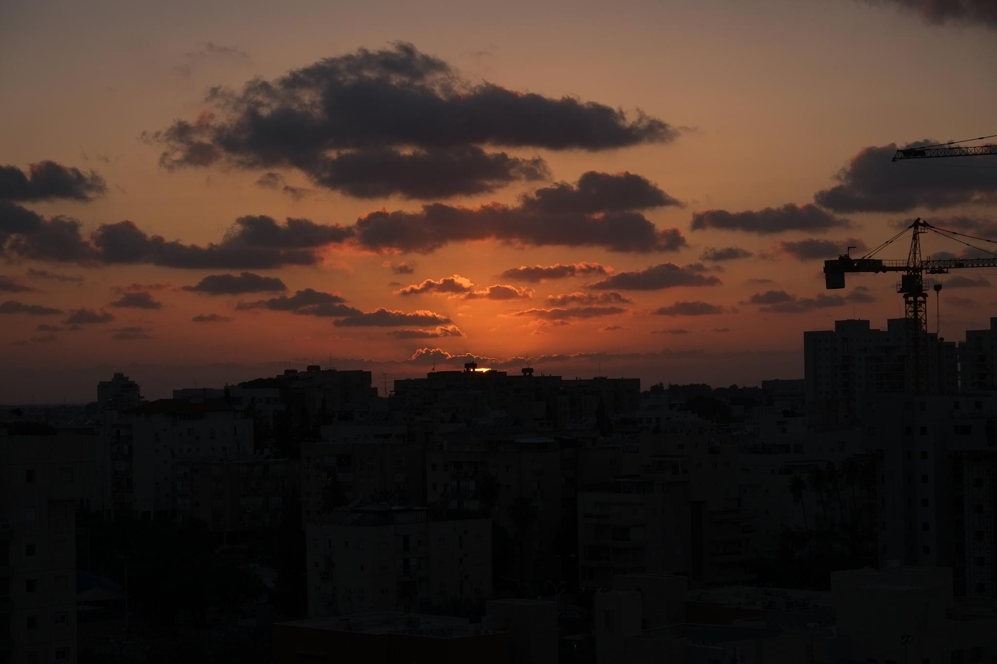 city sunset by doron