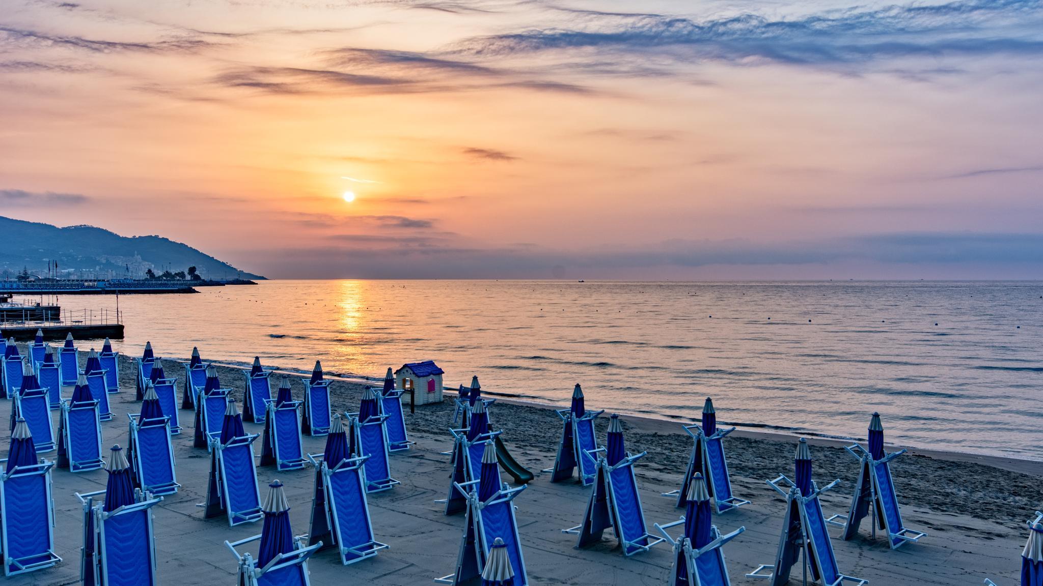 Sunrise on the beach by poggicarlo