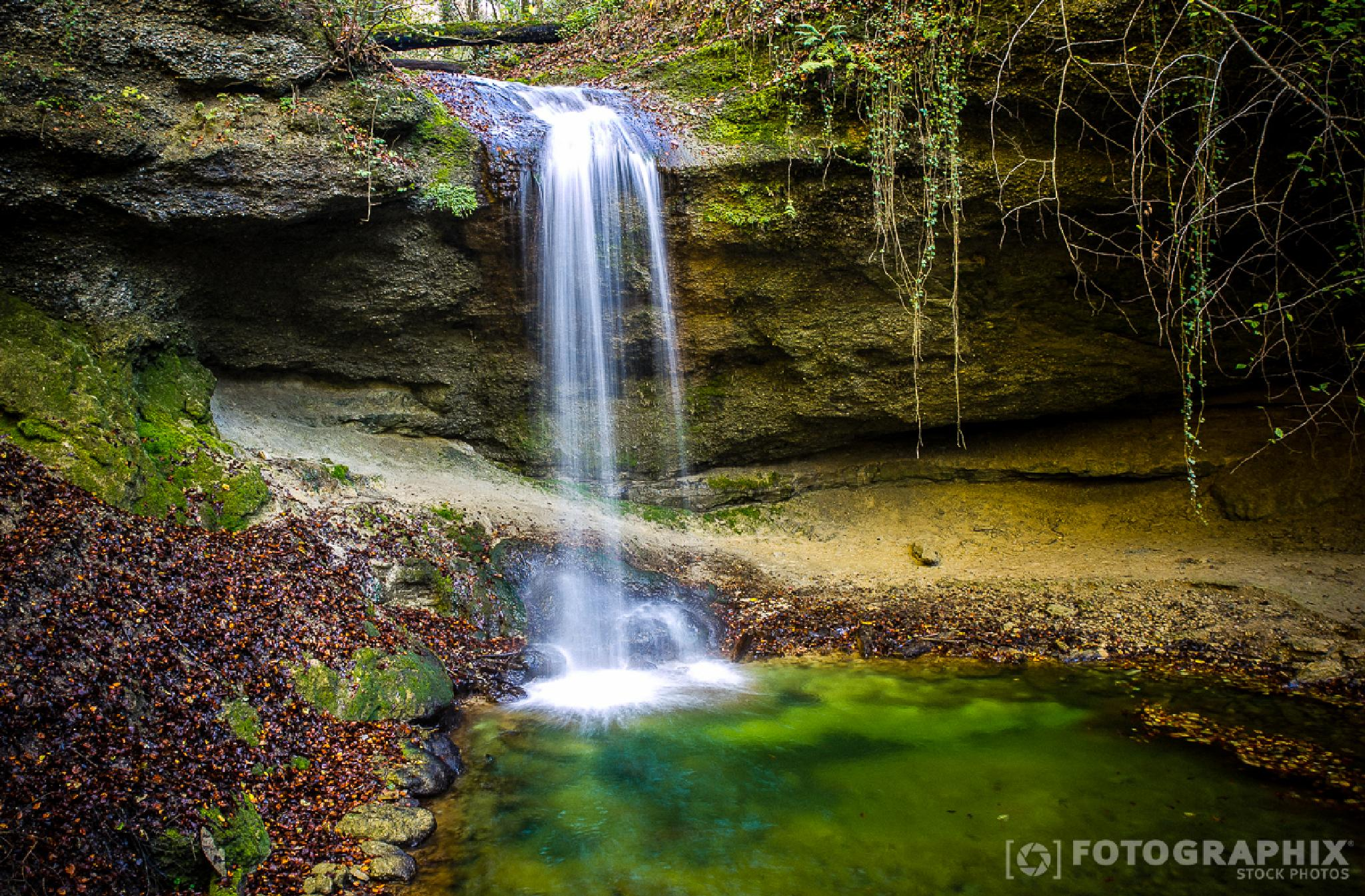 Waterfall in the woods by fotographix