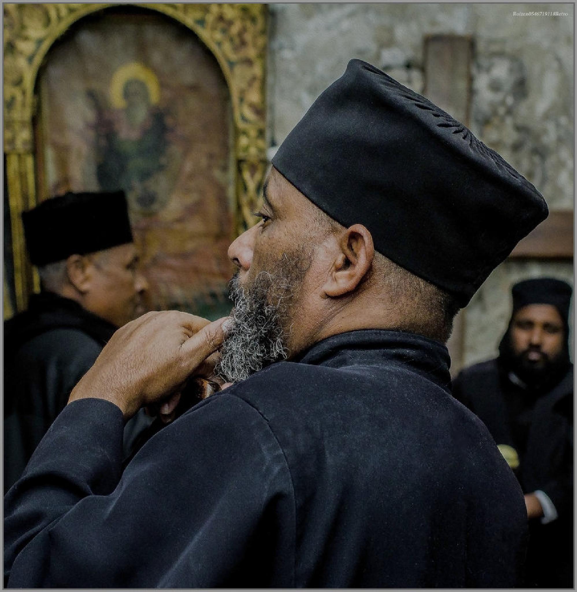 Ethiopian Orthodox Christians during the evening prayer by SHMUAL HAVA RETRO
