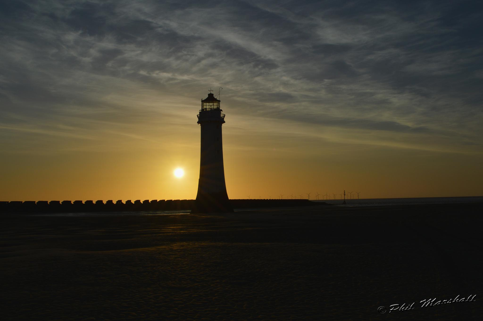 Sunset on the lighthouse by Phil Marshall