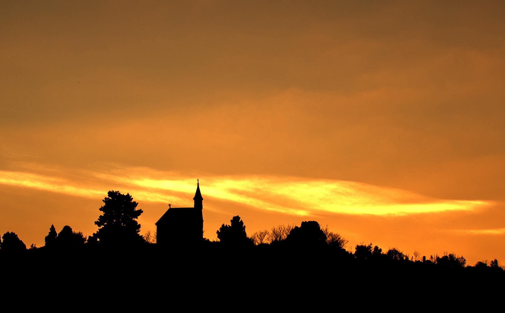 Photo in Landscape #church #hill #top #trees #sun #sunset