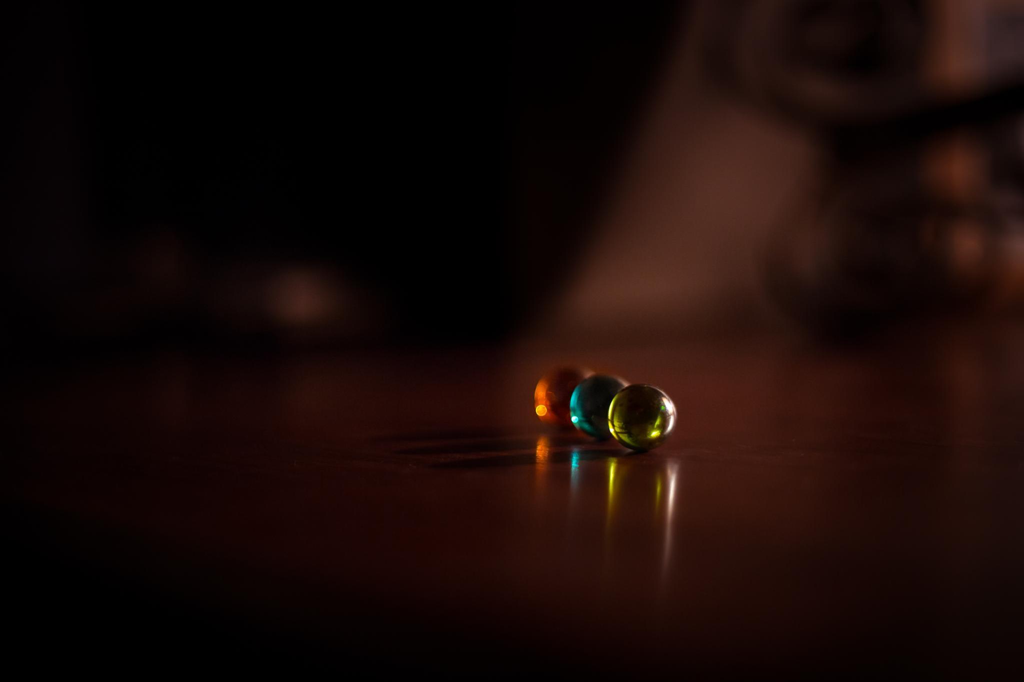 Three Marbles on my desk by Stephan Du Toit