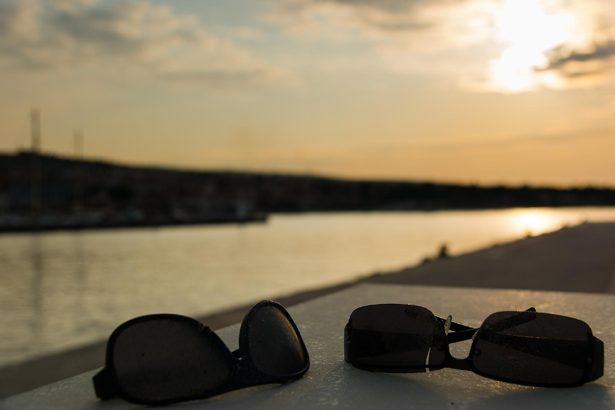 Photo in Still Life #sunset #broken glasses #sea #clouds