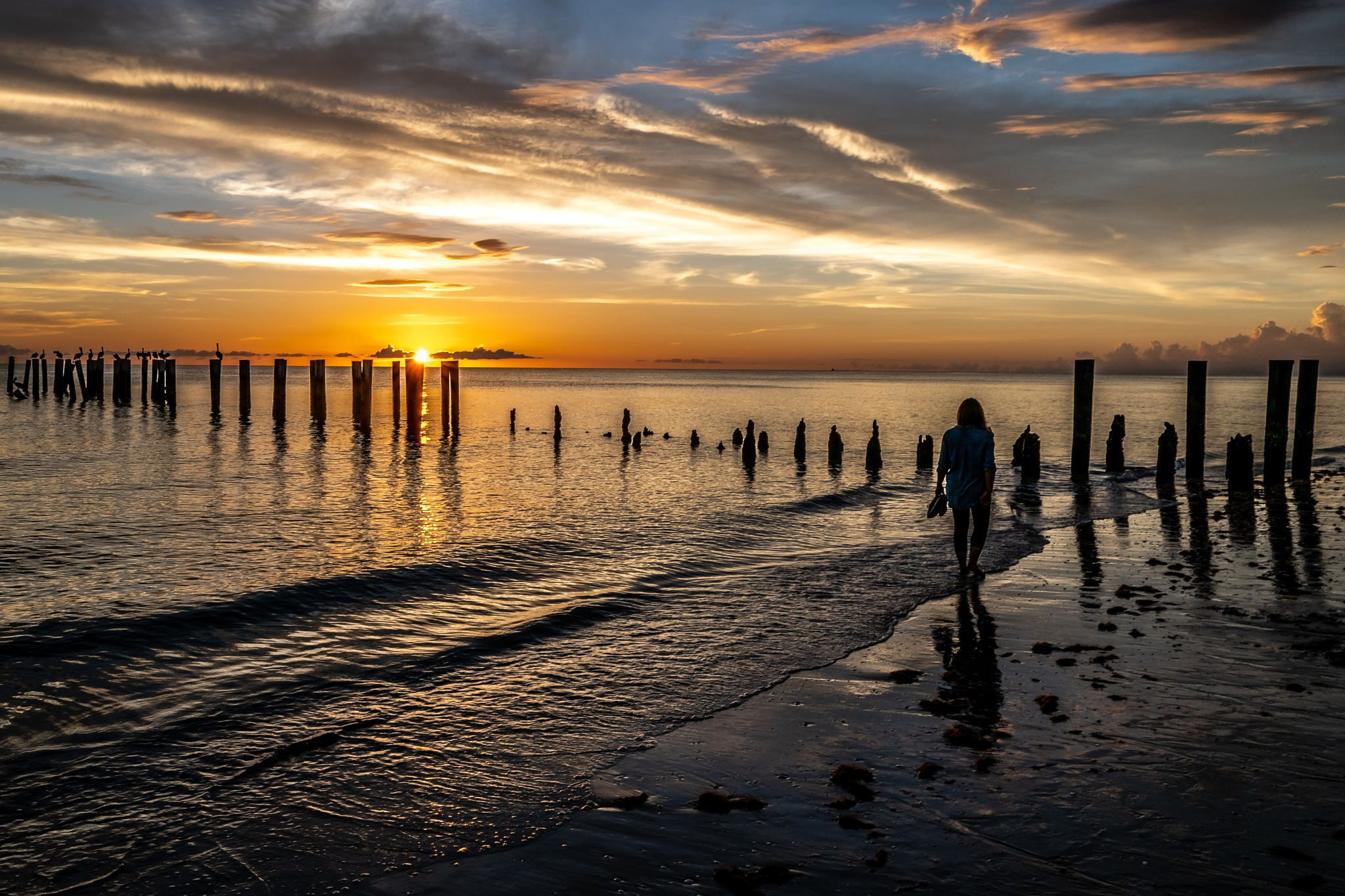 Walking on the beach by Omar Gomez