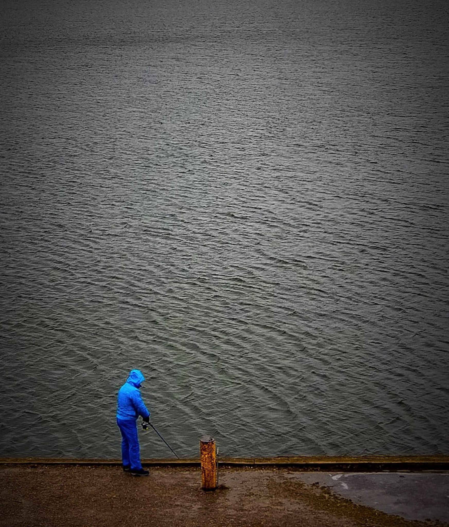 Lonesome fisherman, no fish today.  by Ronnie Ericson