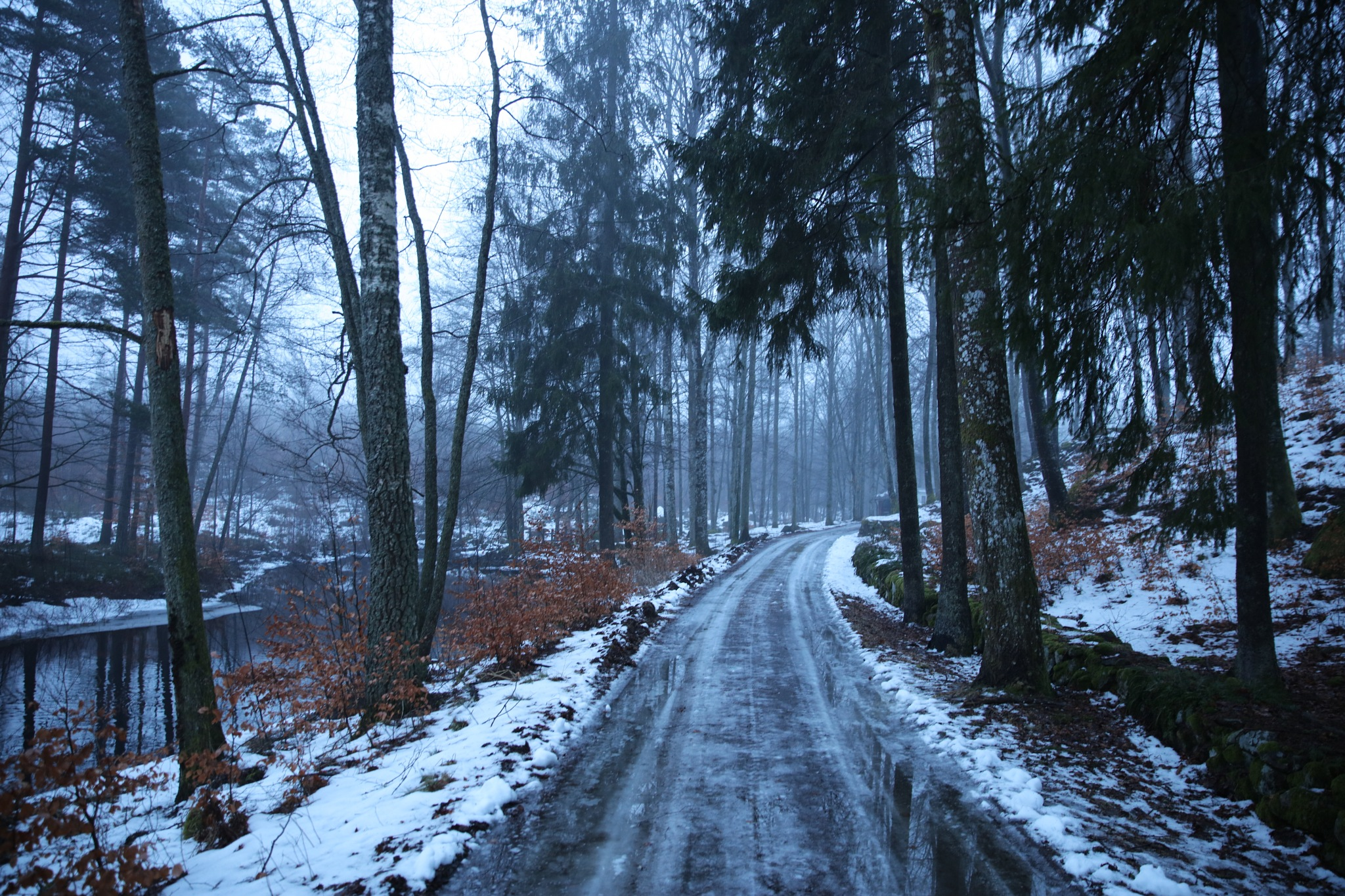 Rain after snow, road is wet and slippery by peterliendeborg