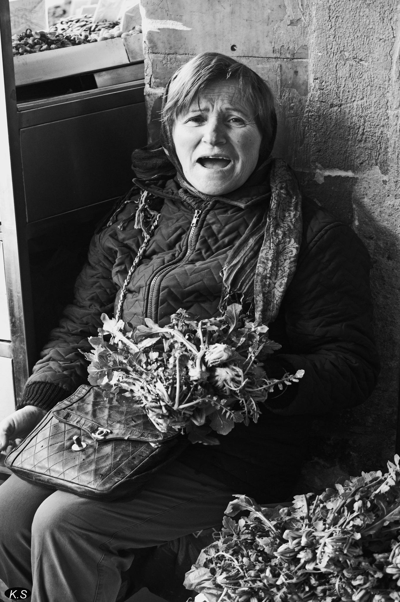 woman selling vegetables by Katherine.Soulis
