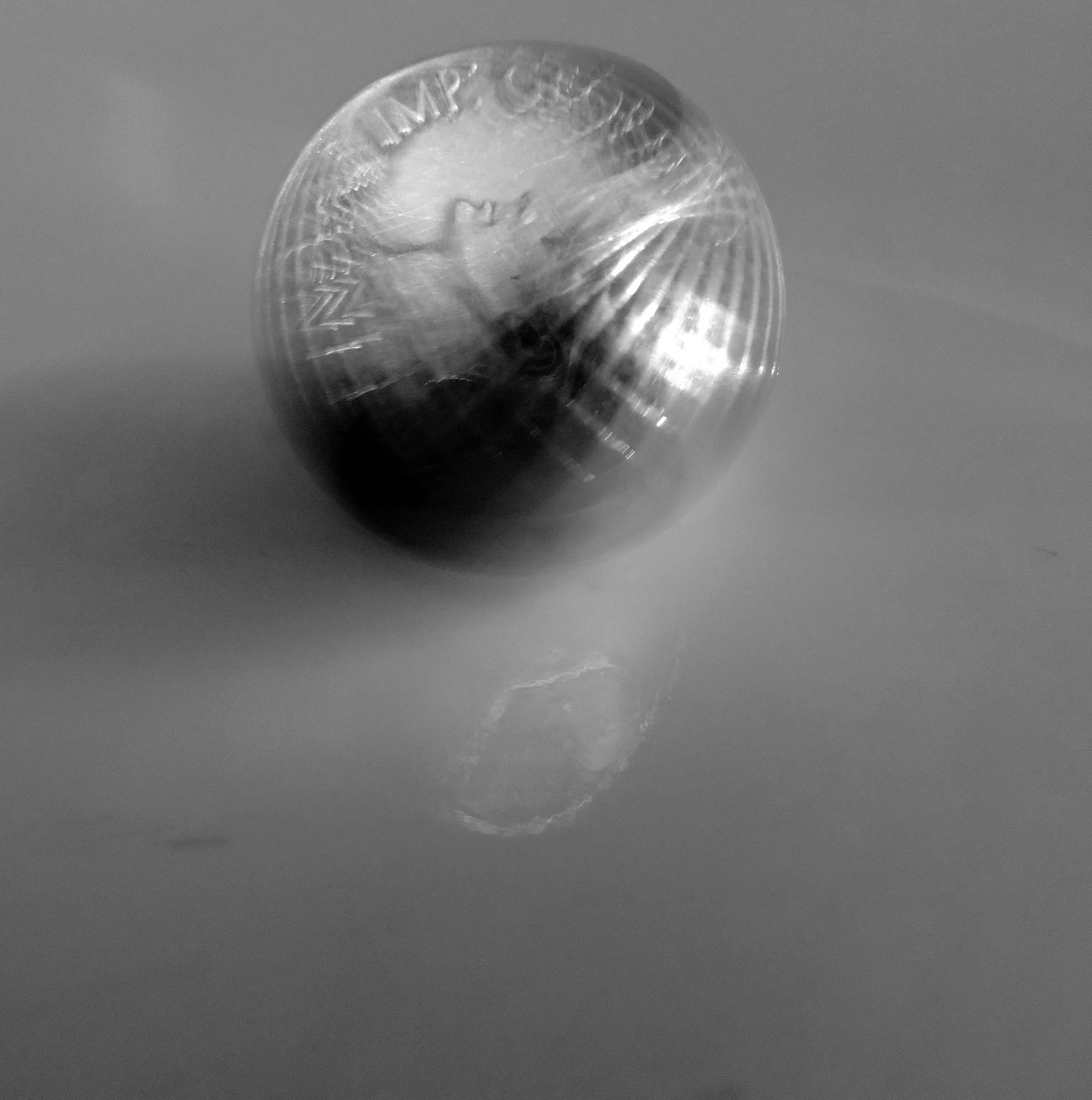 rotating coin  by annapoorna.sitaram