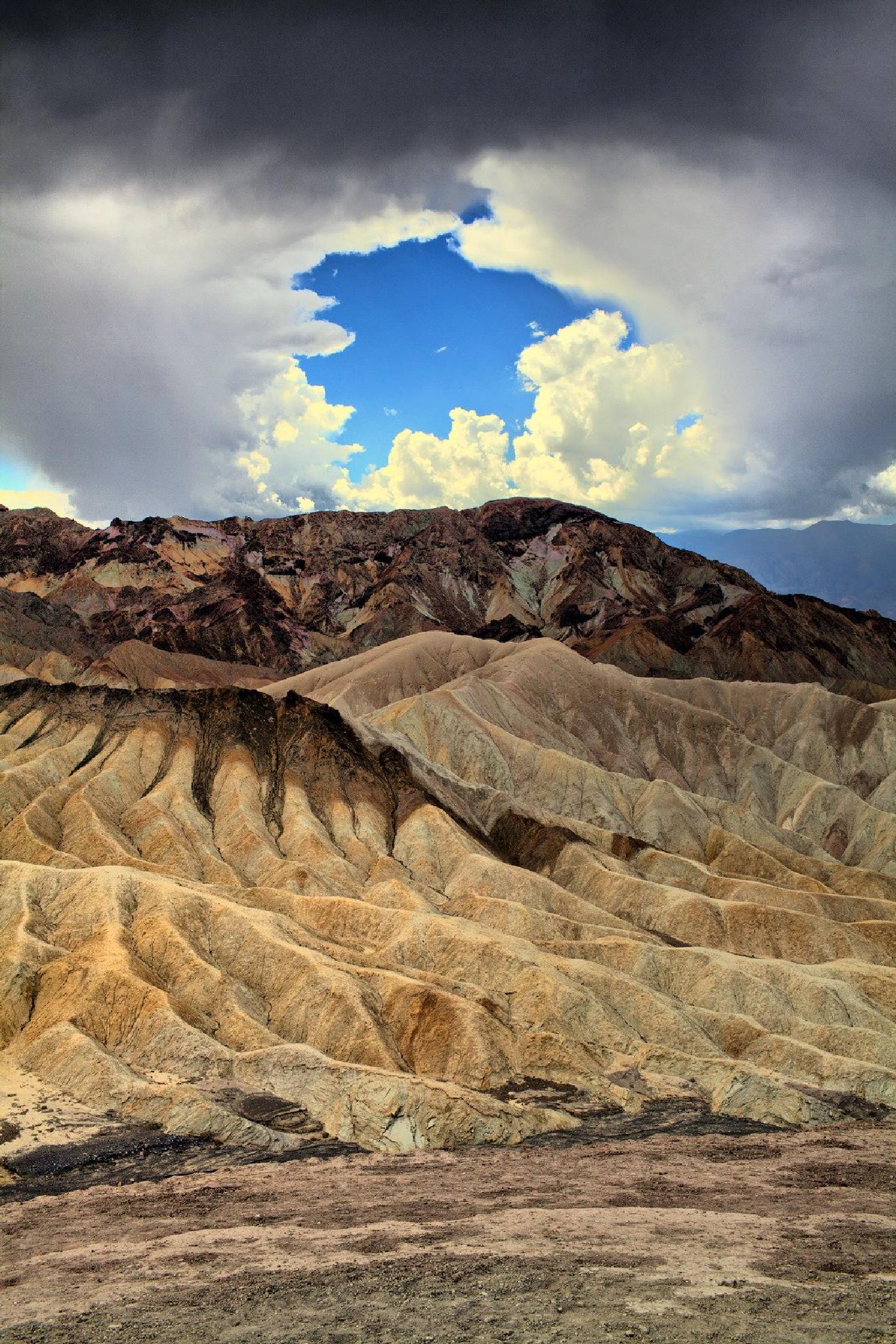 Hole in the sky. Zabriskie Point, Death Valley, California by Mikhail Rybakov
