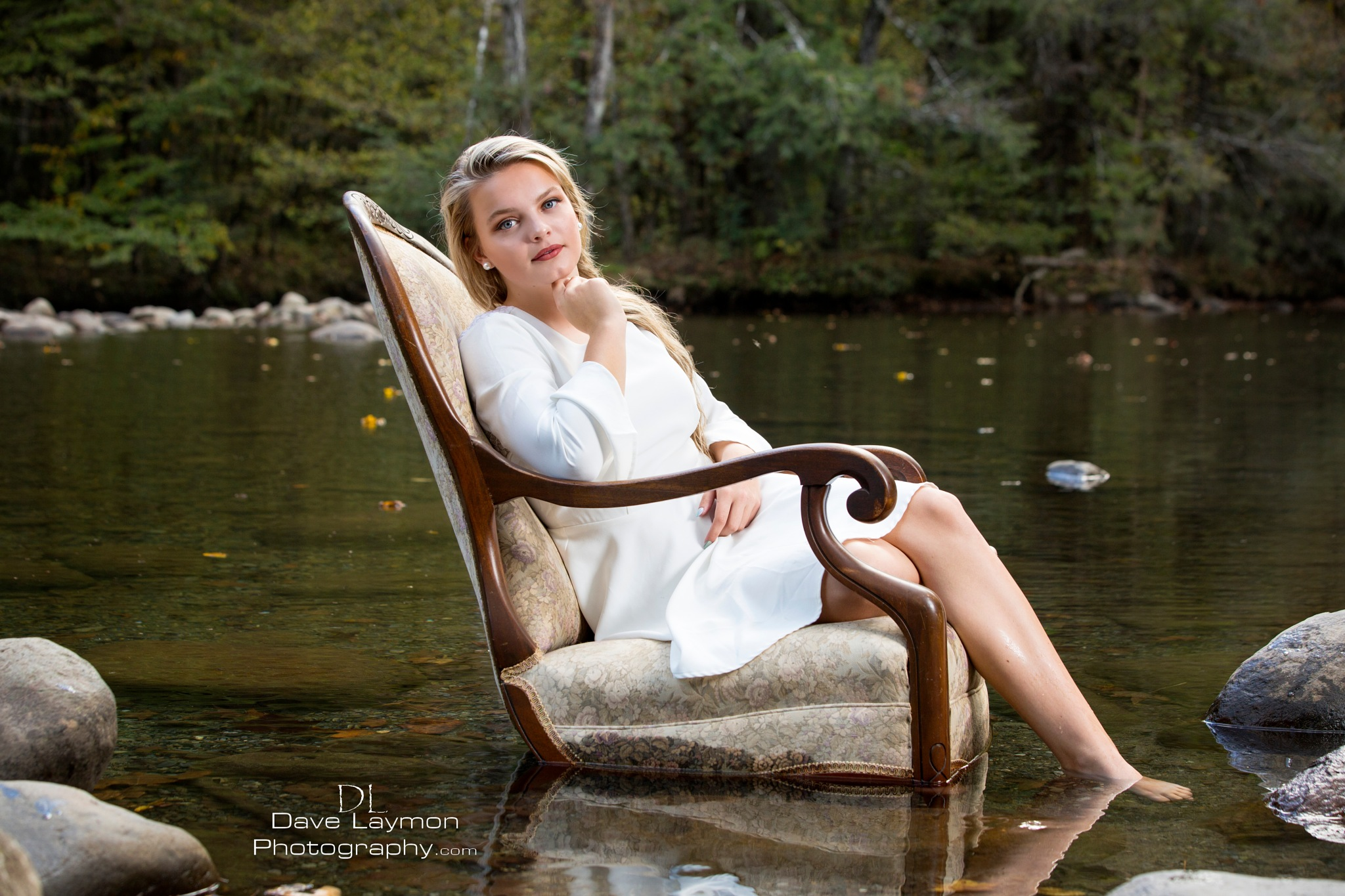 Chair in the creek by Dave Laymon
