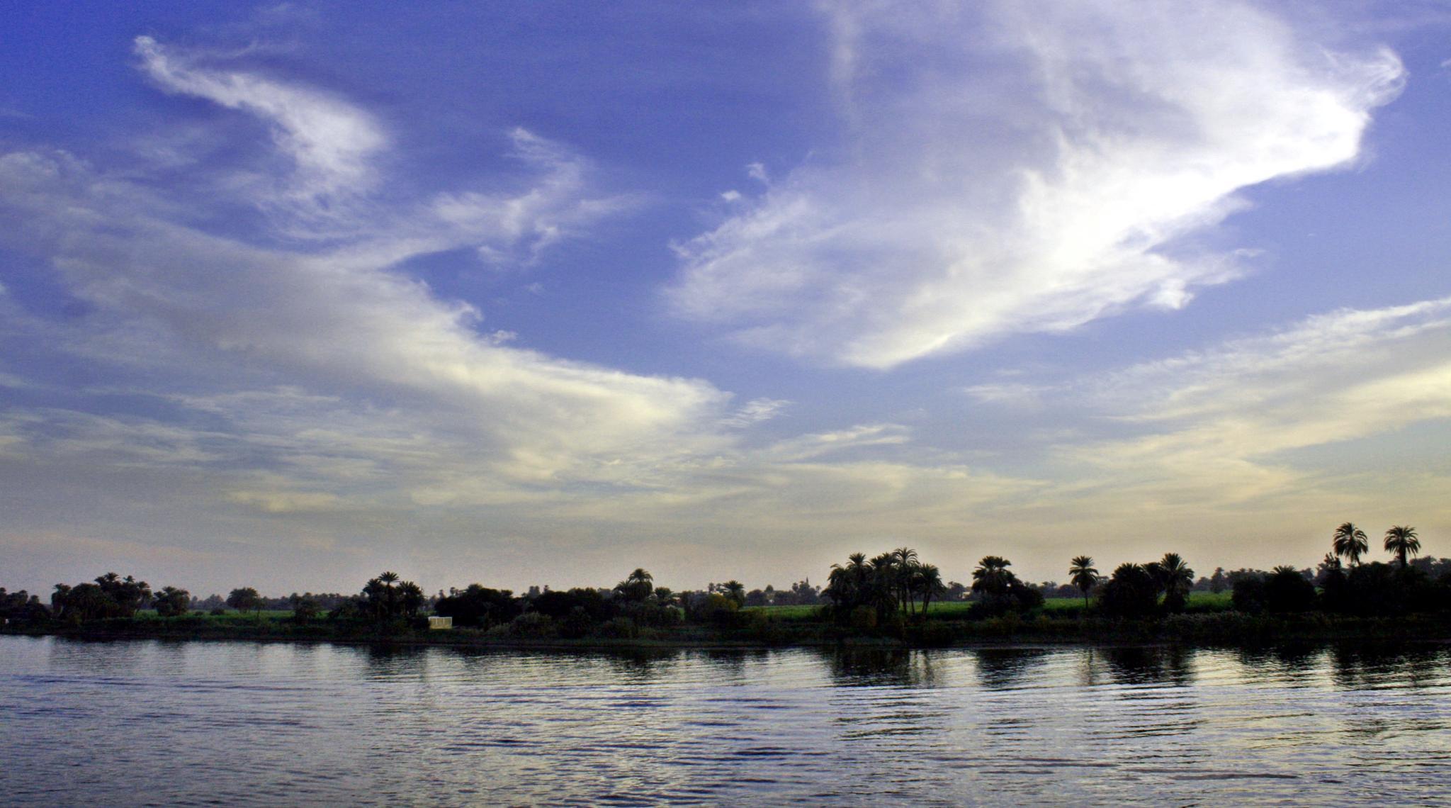 Egytian sky over Nile by Mkorho