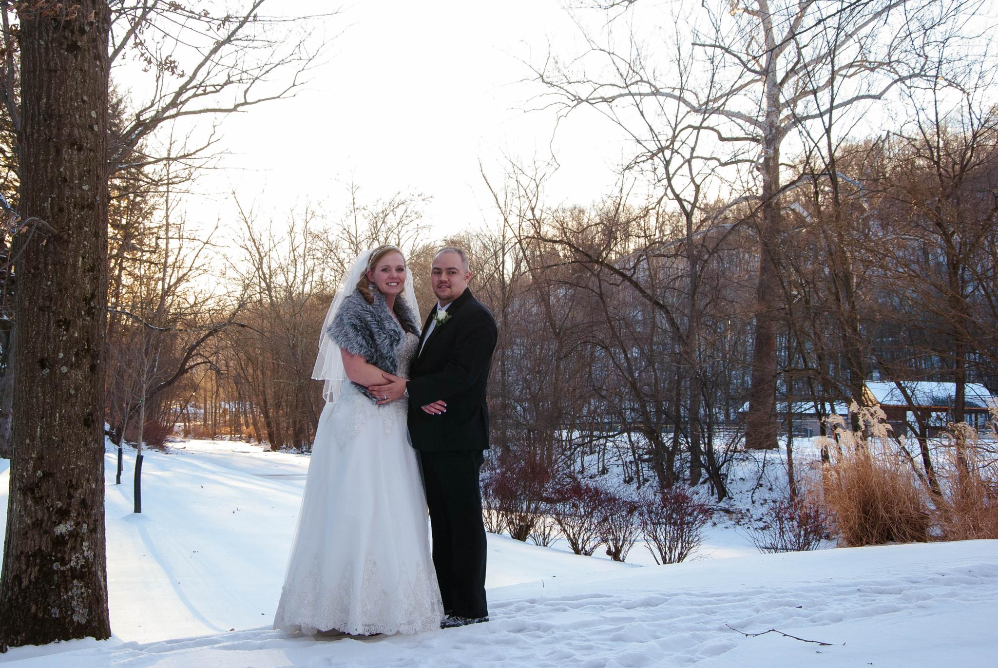 Bride & Groom in the setting sun by Behind the Lenz