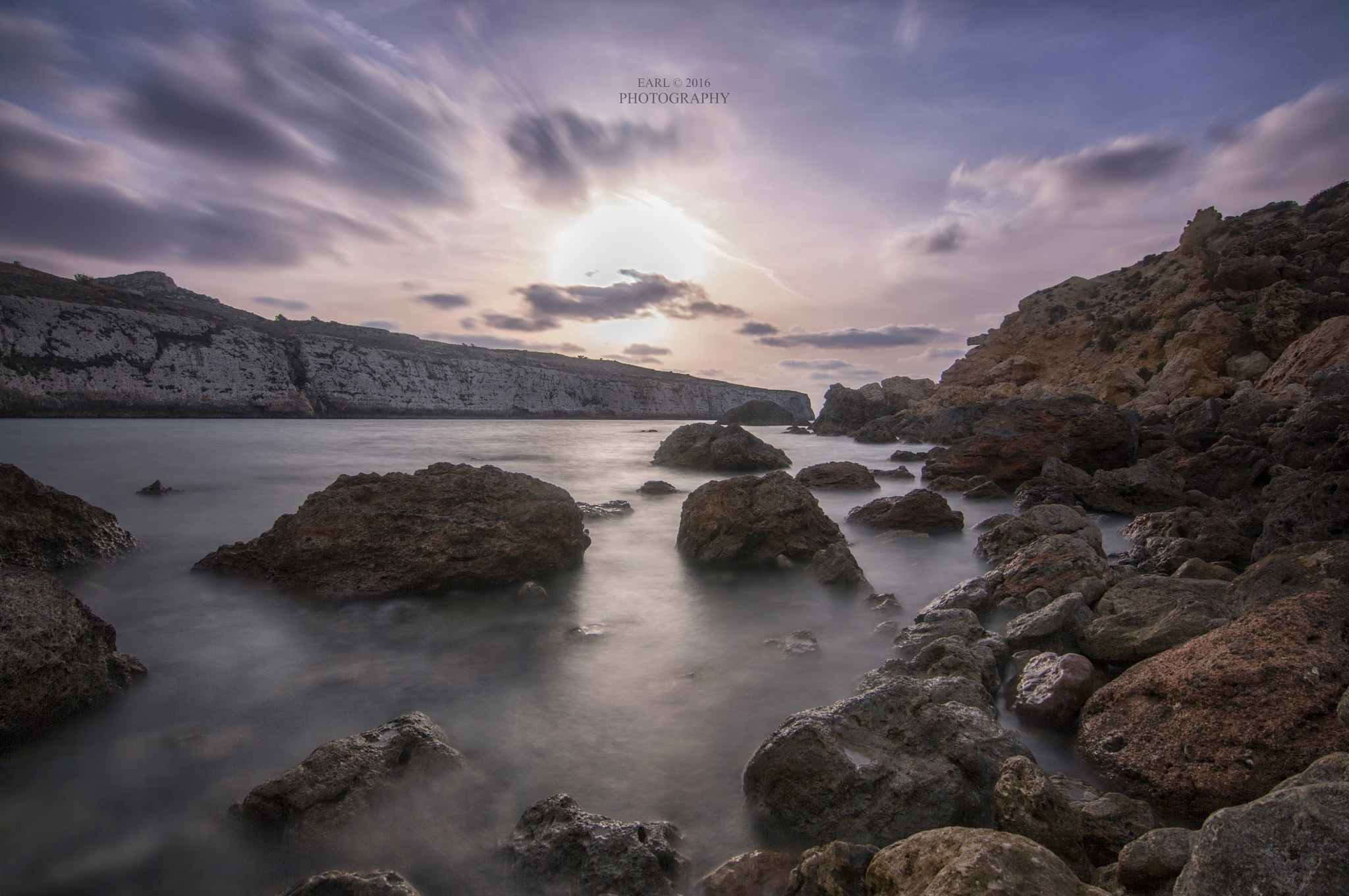 Sunset With Rocks by Earl