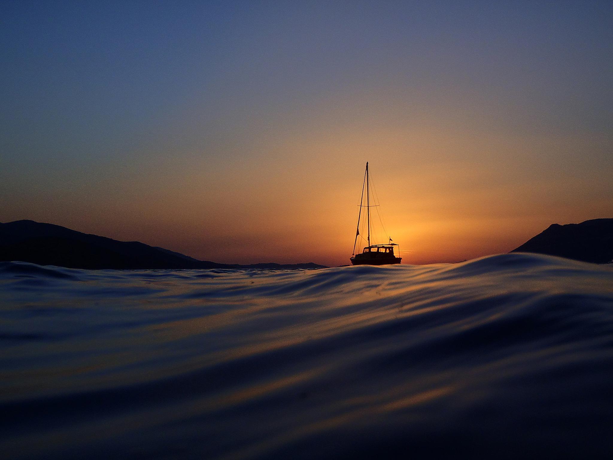 Boat at sunset by Tonči Bernetić