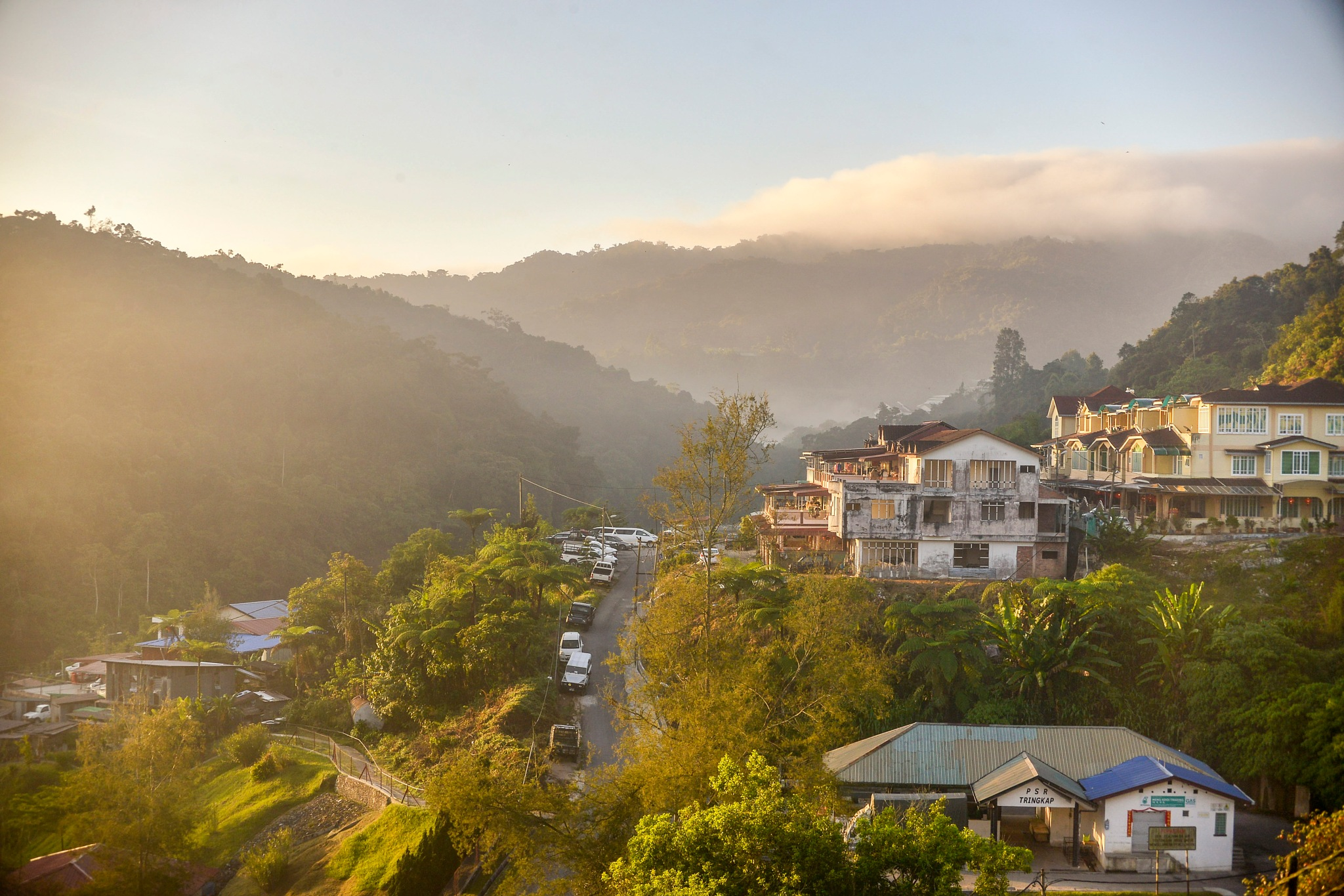 foggy morning at houses in mountain  by garywlyip