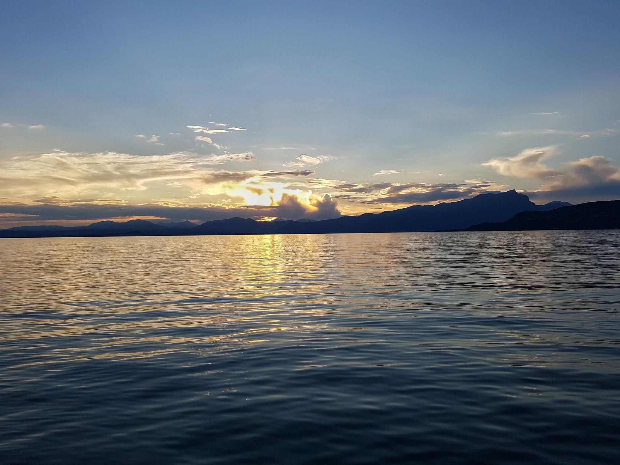sunset from Garda lake by cicloturista62