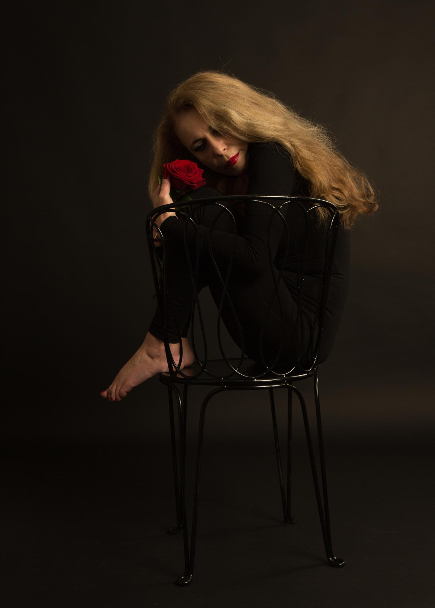 Simona on a chair, in a black dancing dress by NilsAxelBraathen