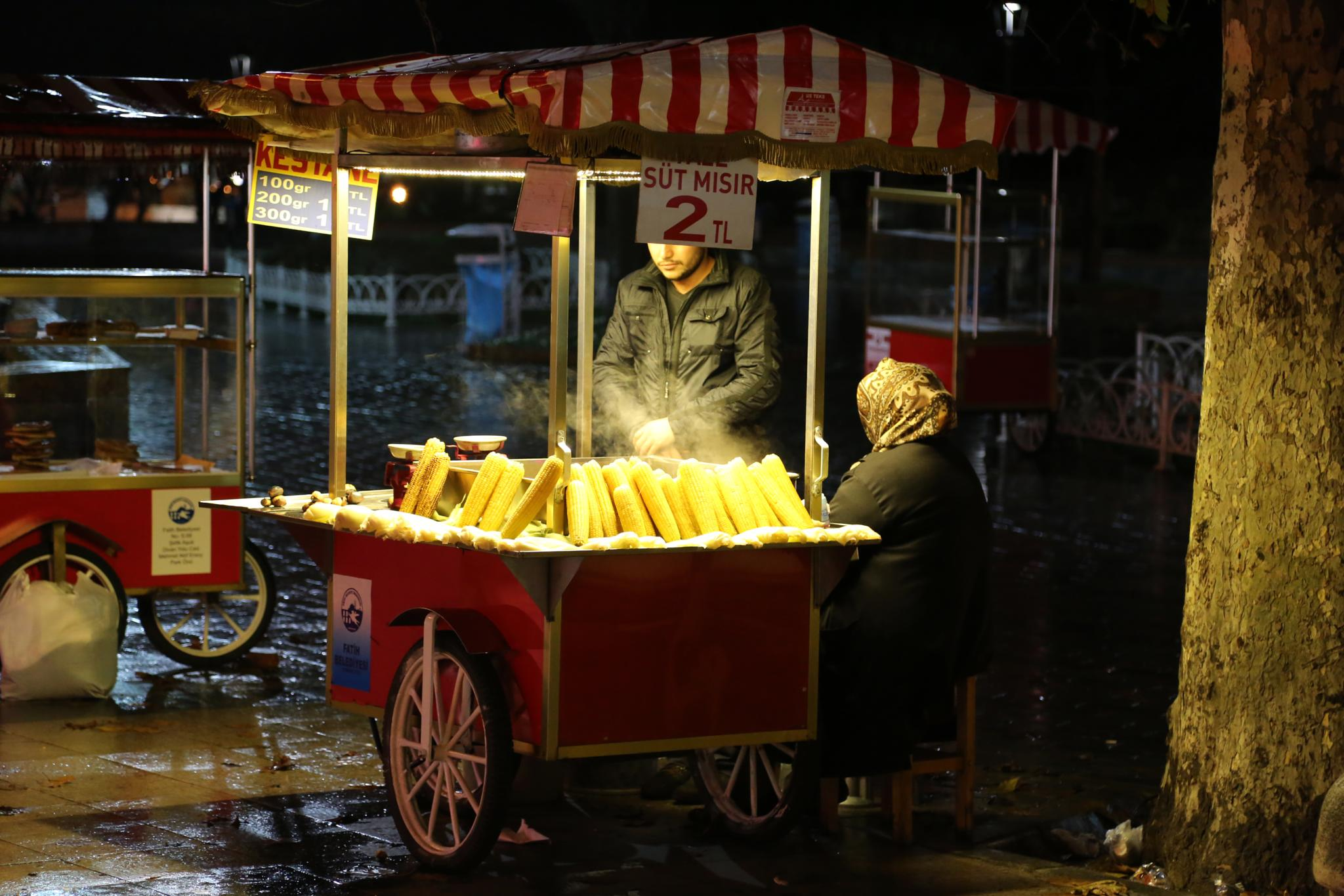 Grilled corn vendor - lady by bechara.yared